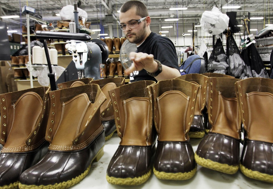 "FILE-In this Dec. 14, 2011 file photo, Eric Rego stitches boots in the facility where LL Bean boots are assembled in Brunswick, Maine. LL Bean CEO Chris McCormick told workers that the Maine-based retailer has been conservative for the past few years and is now ready to ""accelerate our growth plans and grab market share."" That plan includes pumping an additional $100 million into its website, retail expansion and business systems, he said. (AP Photo/Pat Wellenbach, files)"
