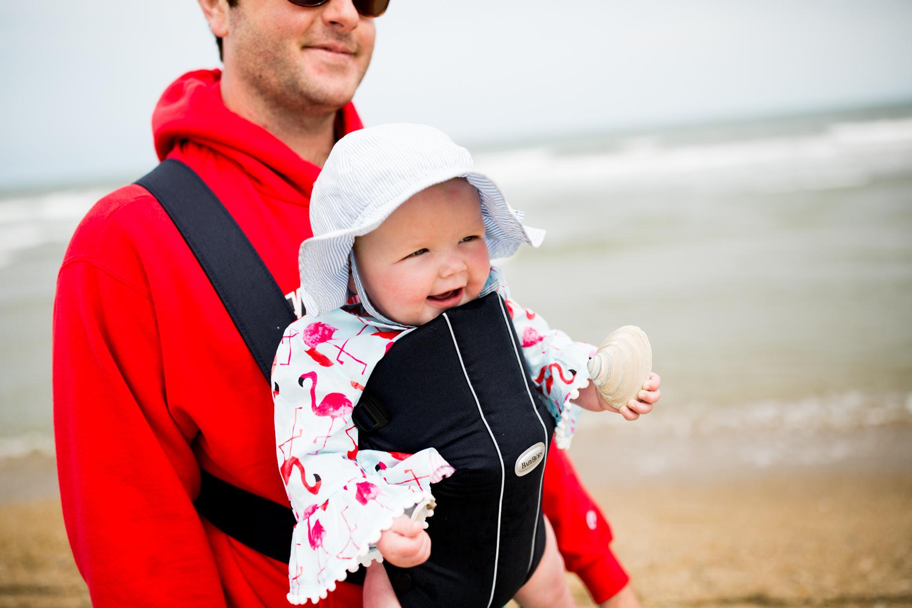 Emma in her new seersucker swimsuit, her matching seersucker sun hat, andher flamingo coverup