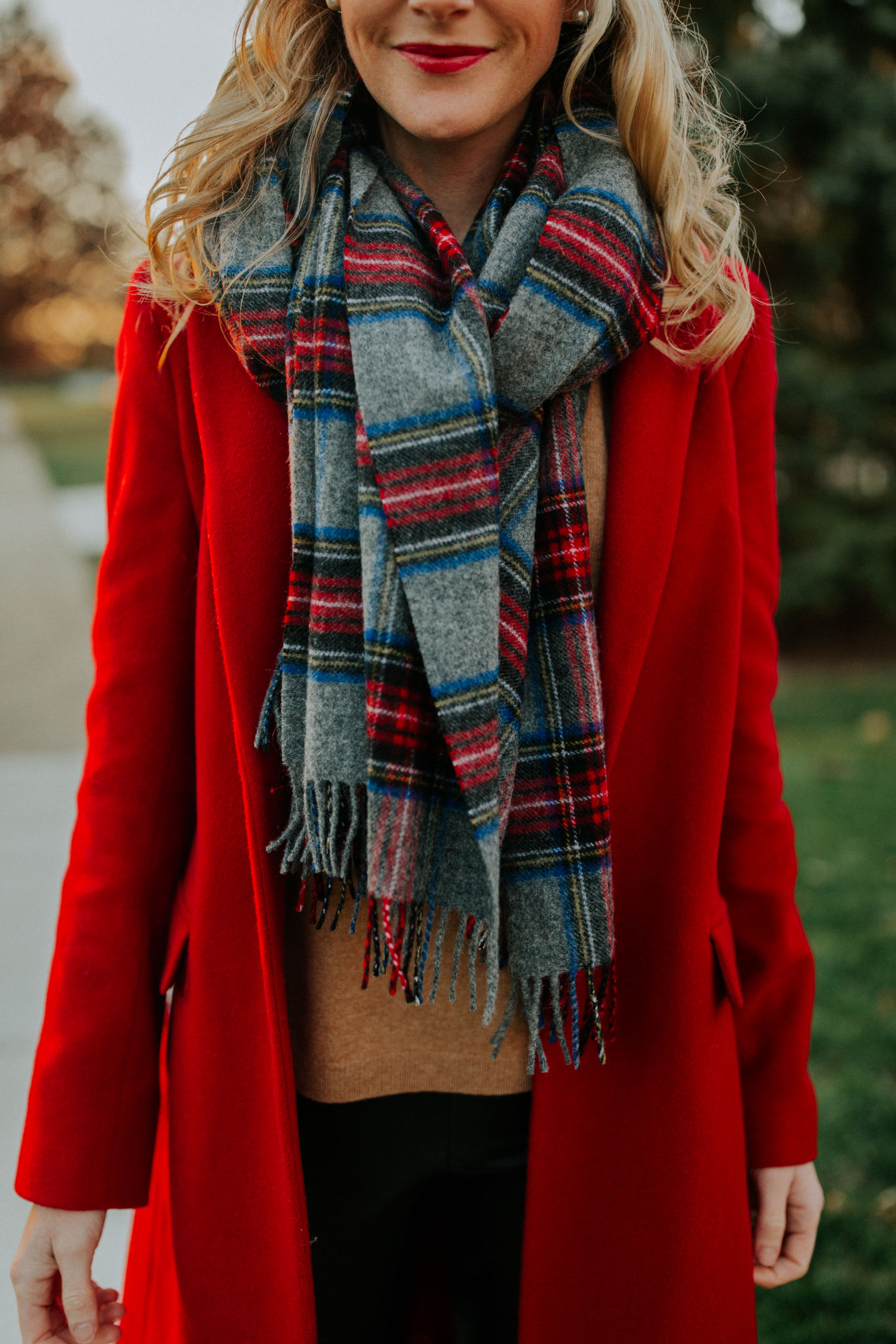Casual Preppy Christmas Outfit: Plaid scarf, red coat, red lips