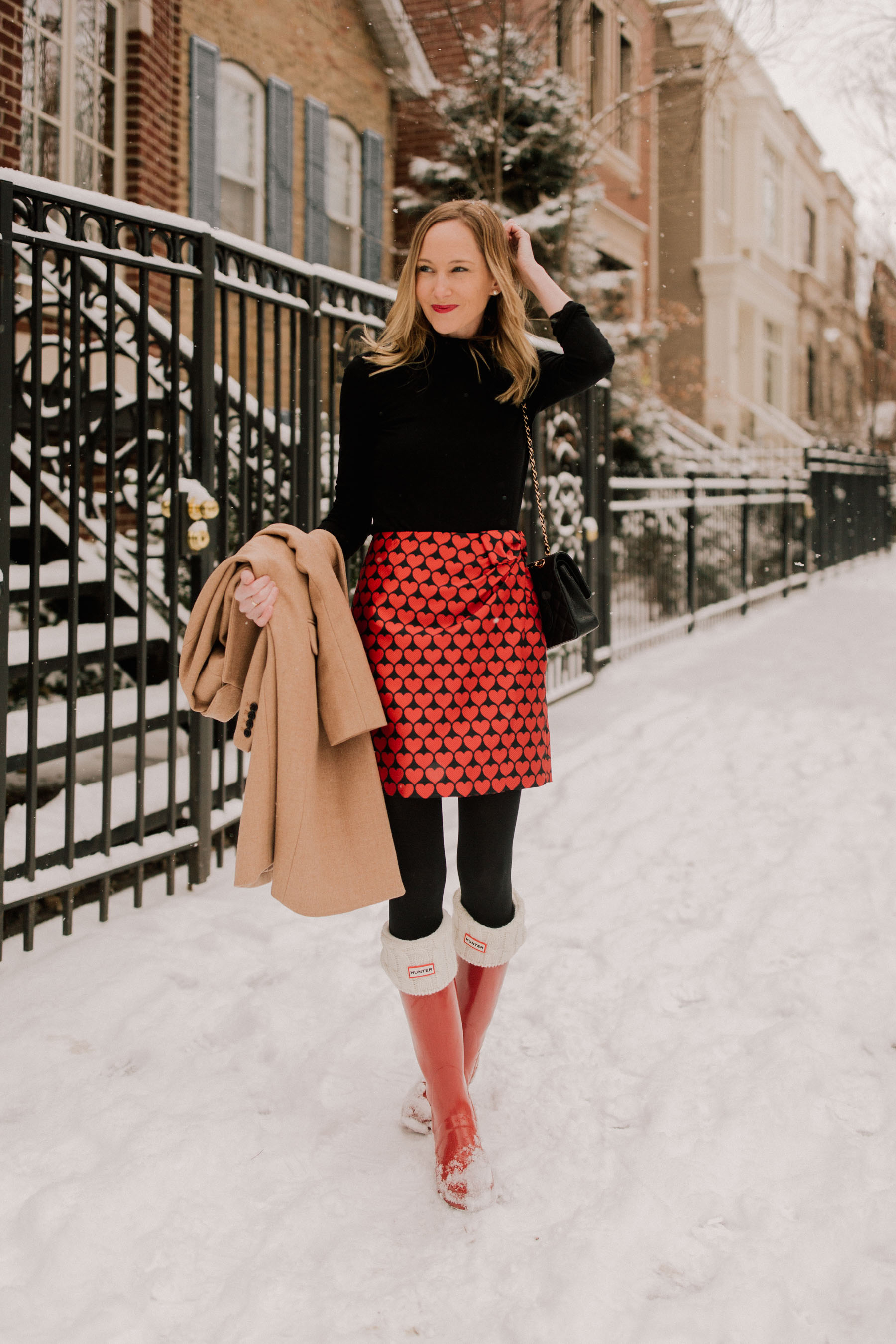Valentine's Day Outfit - Heart Skirt / J.Crew Topcoat / Chanel Bag / Black Turtleneck / Hunter Boots / Black Tights - Kelly in the City