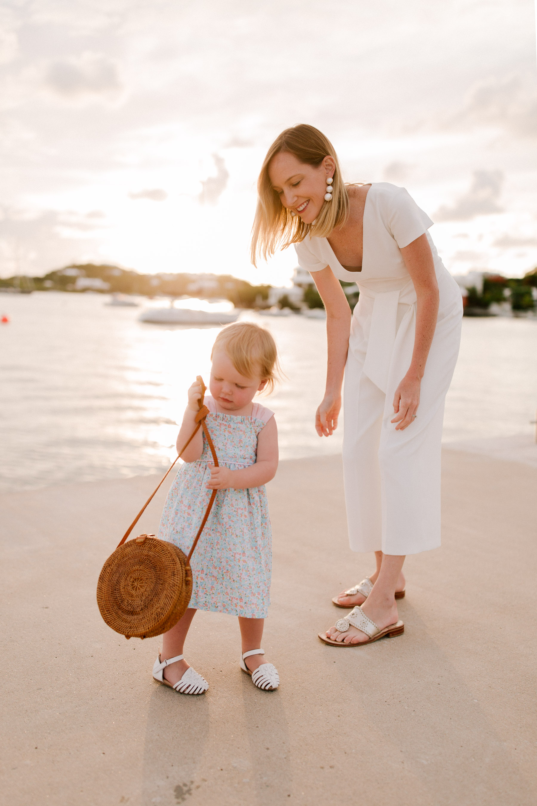 Club Monaco Jumpsuit  / Poppy + Sage Bag / Jack Rogers Sandals / Moon and Lola Earrings / Emma's Smocked Auctions Dress c/o and Sandals / - Kelly in the City