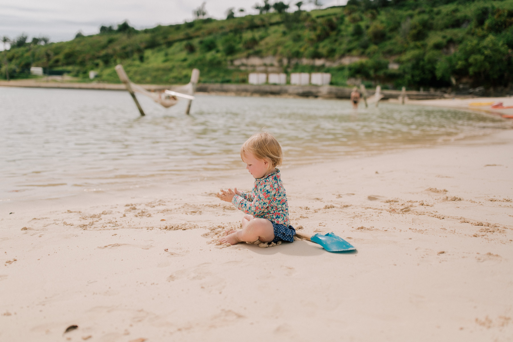 Baby Emma playing at a Private Bermudian Beach | Kelly in the City