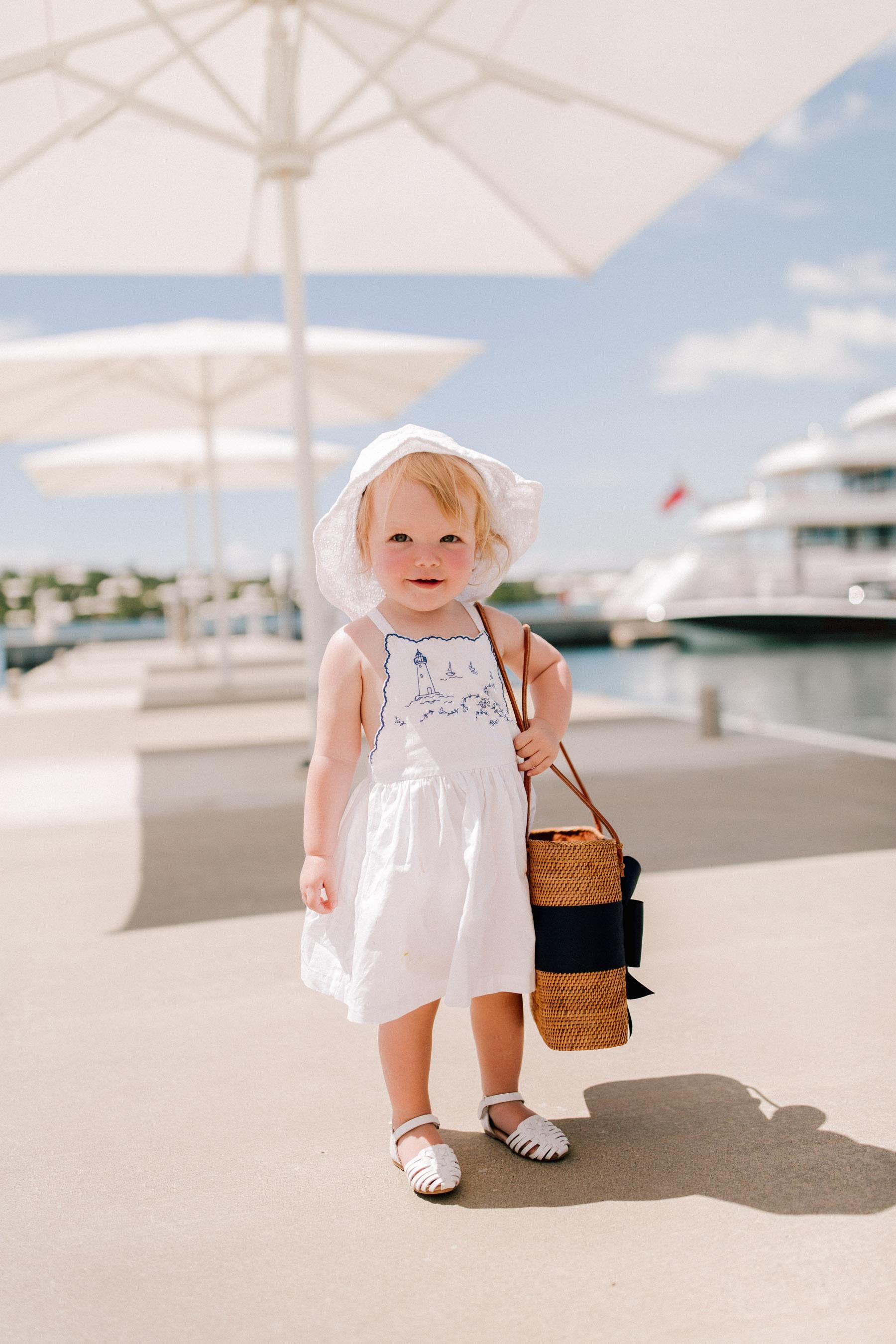 Emma is wearing a Embroidered Cotton Dress - Ralph Lauren