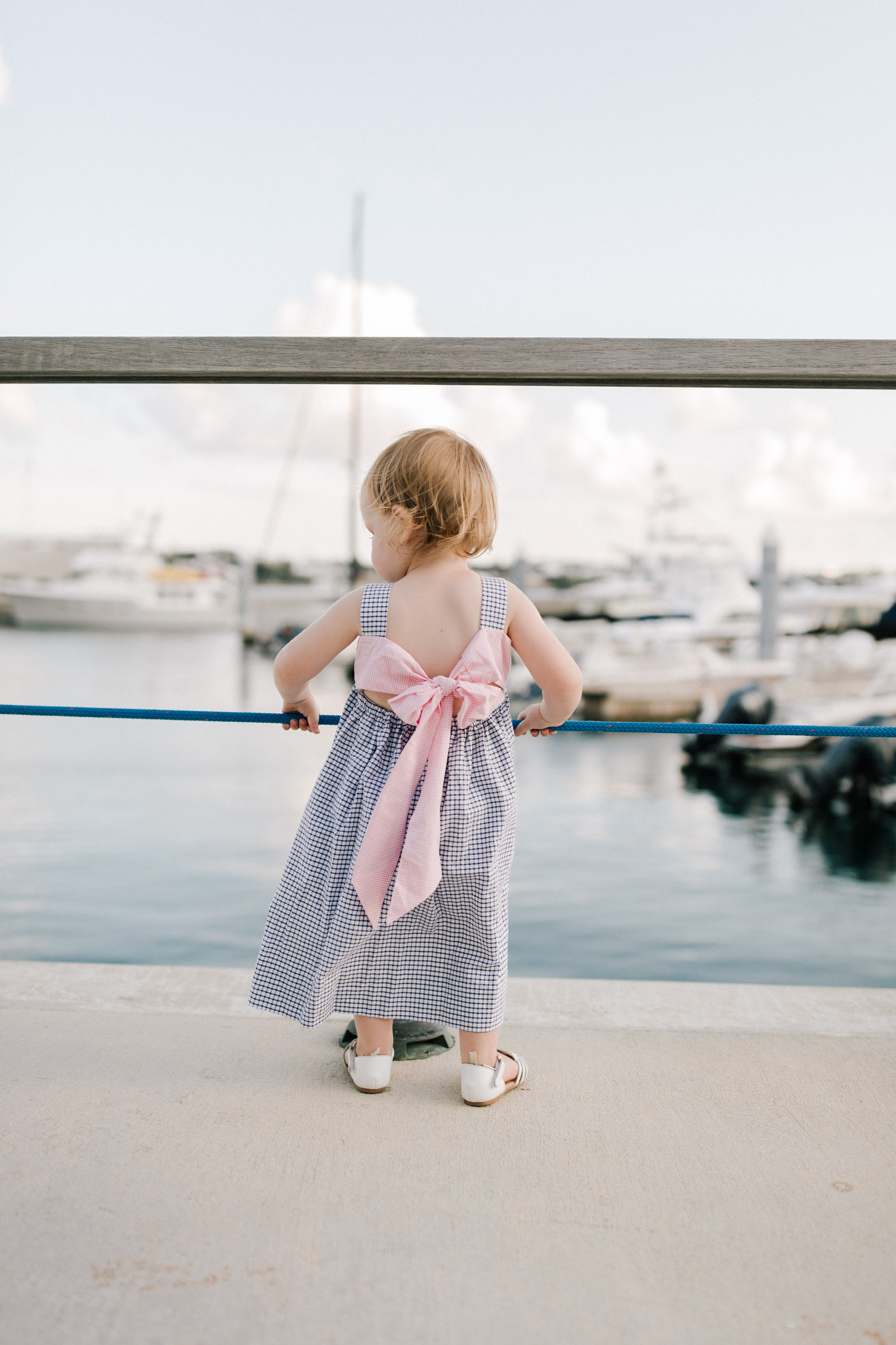 Emma is wearing a Smocked Auctions sailboat dress - Kelly in the City