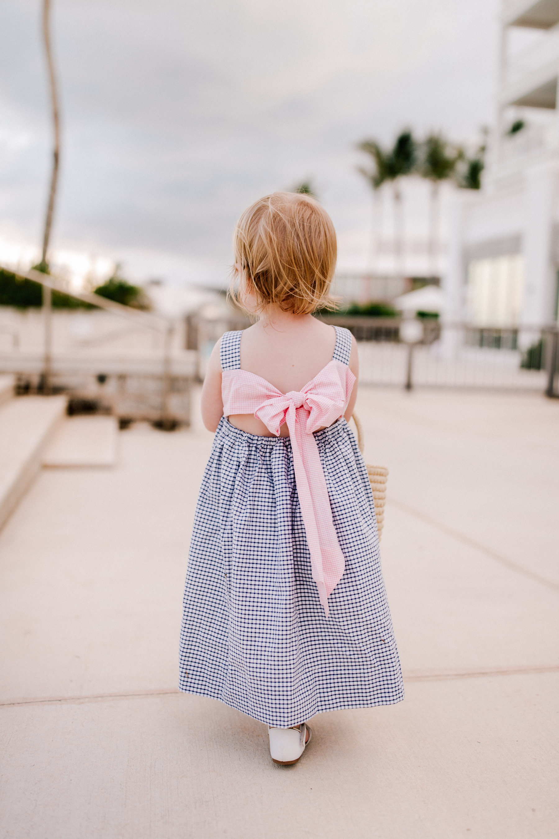 Emma is wearing a Smocked Auctions dress - Kelly in the City