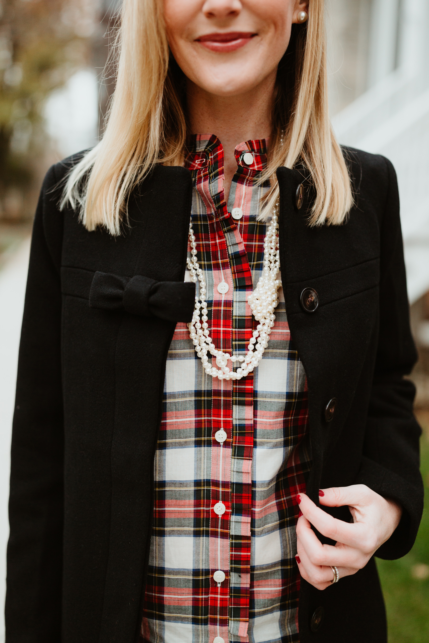 Kelly's Outfit: Tartan Ruffled Shirt, Knotted Pearl Necklace, Bow Coat, Pearl Earrings