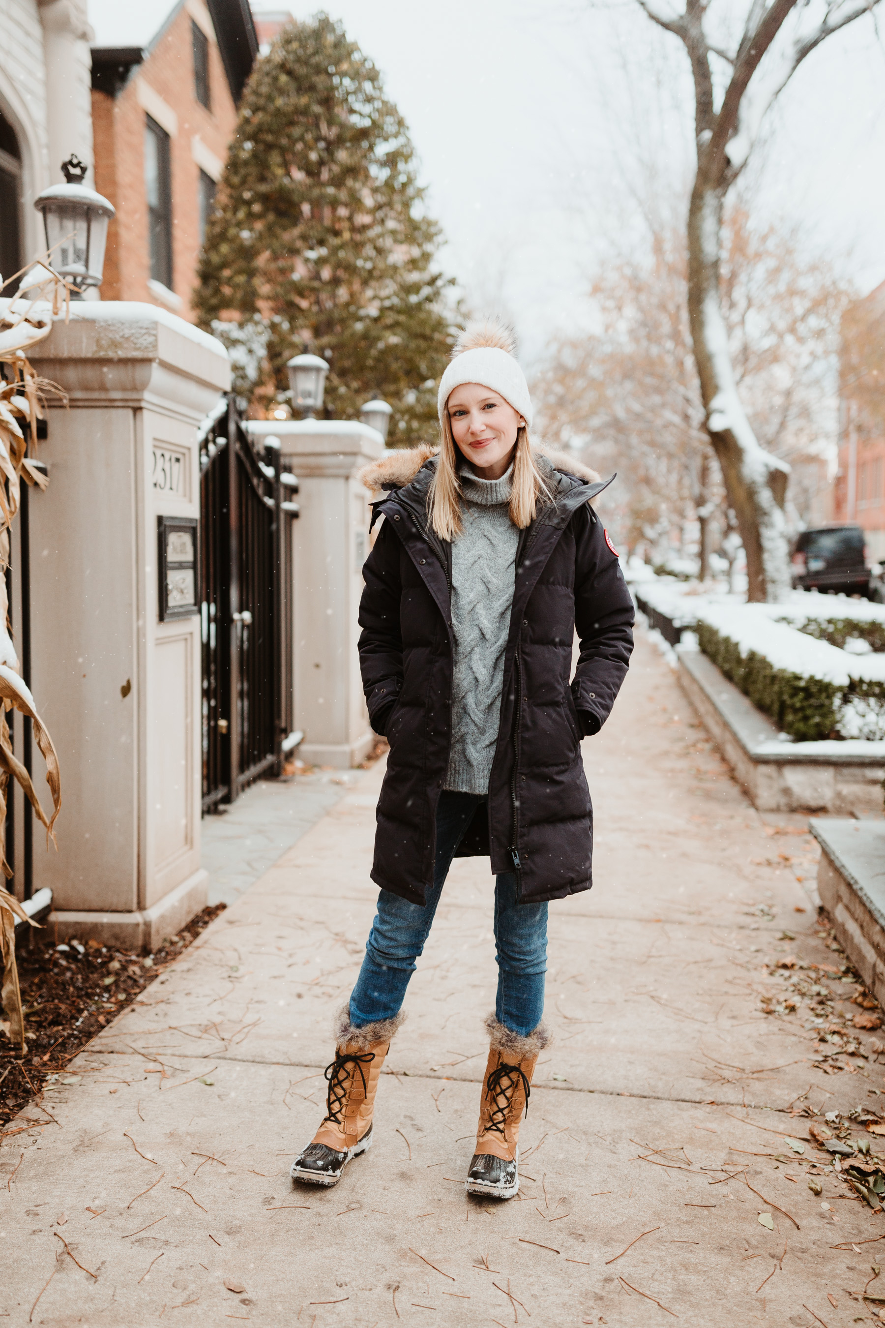Kelly: Cable-Knit Sweater, Navy Down Parka, Sorel Tofino II Boots and DL1961 Jeans