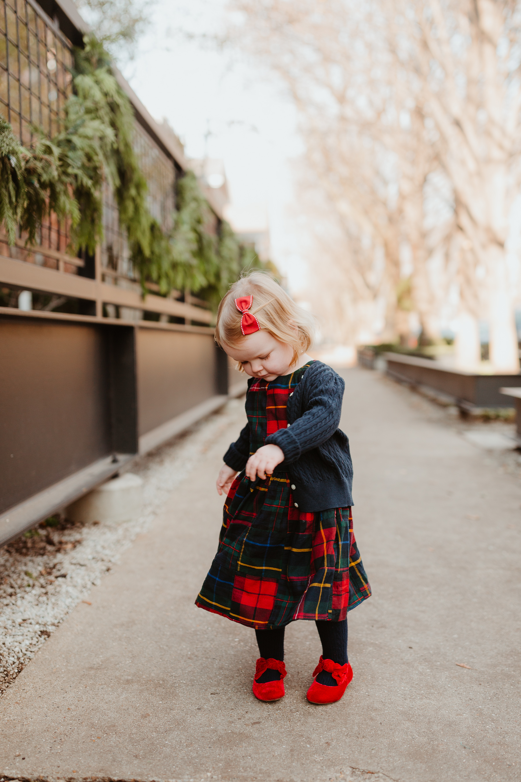 Emma is wearing a Plaid Dress (This is just the cutest, too! More holiday looks here.) / red shoes / navy cardigan - Polo Ralph Lauren