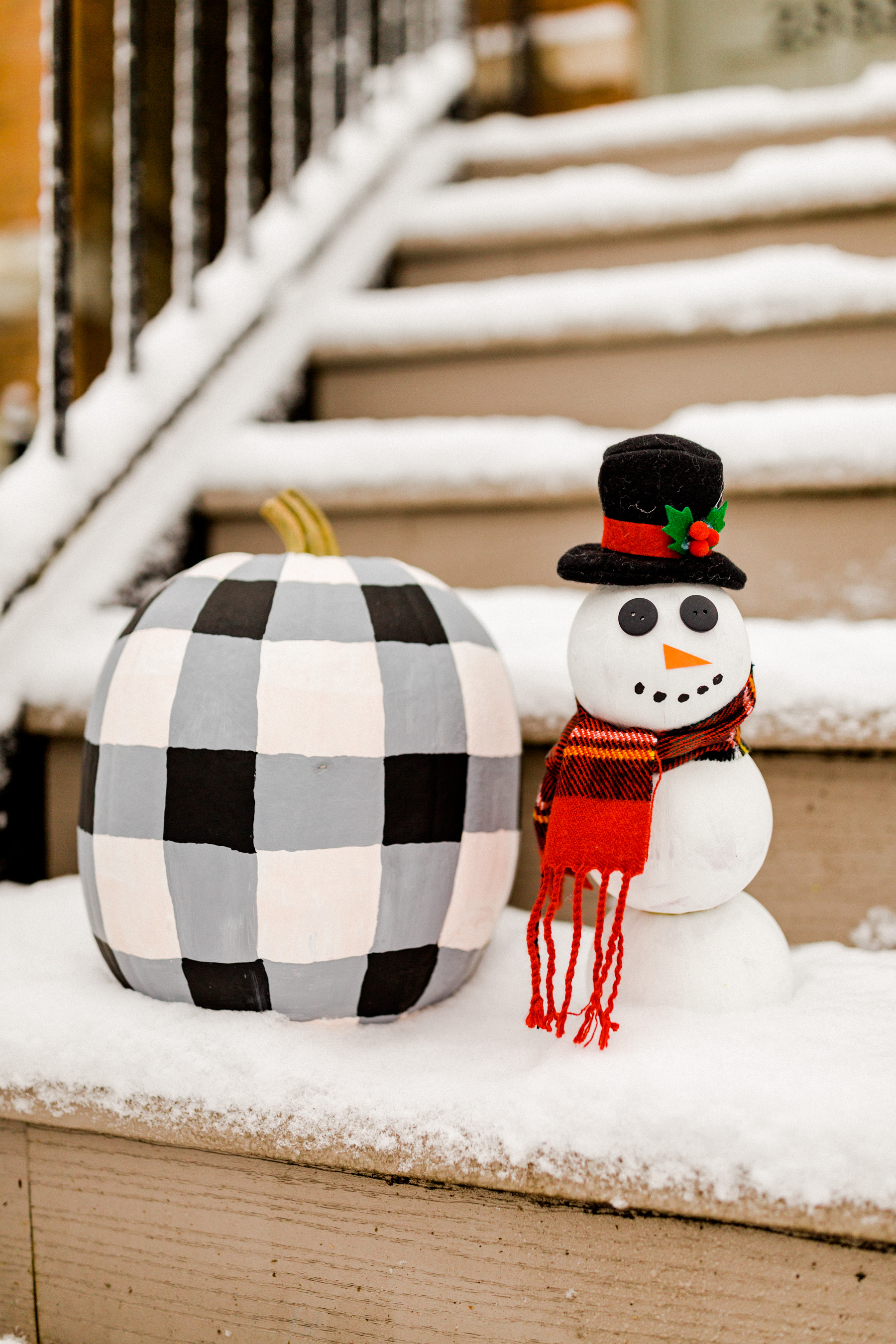 Step Four Buffalo plaid pumpkin: Darken the areas where the vertical and horizontal lines intersect.  Snowman pumpkin: Glue on the buttons, construction paper nose and hat. Tie scarf and paint the mouth! (I removed the head for this stage since it was a bit easier to paint this way, haha.)