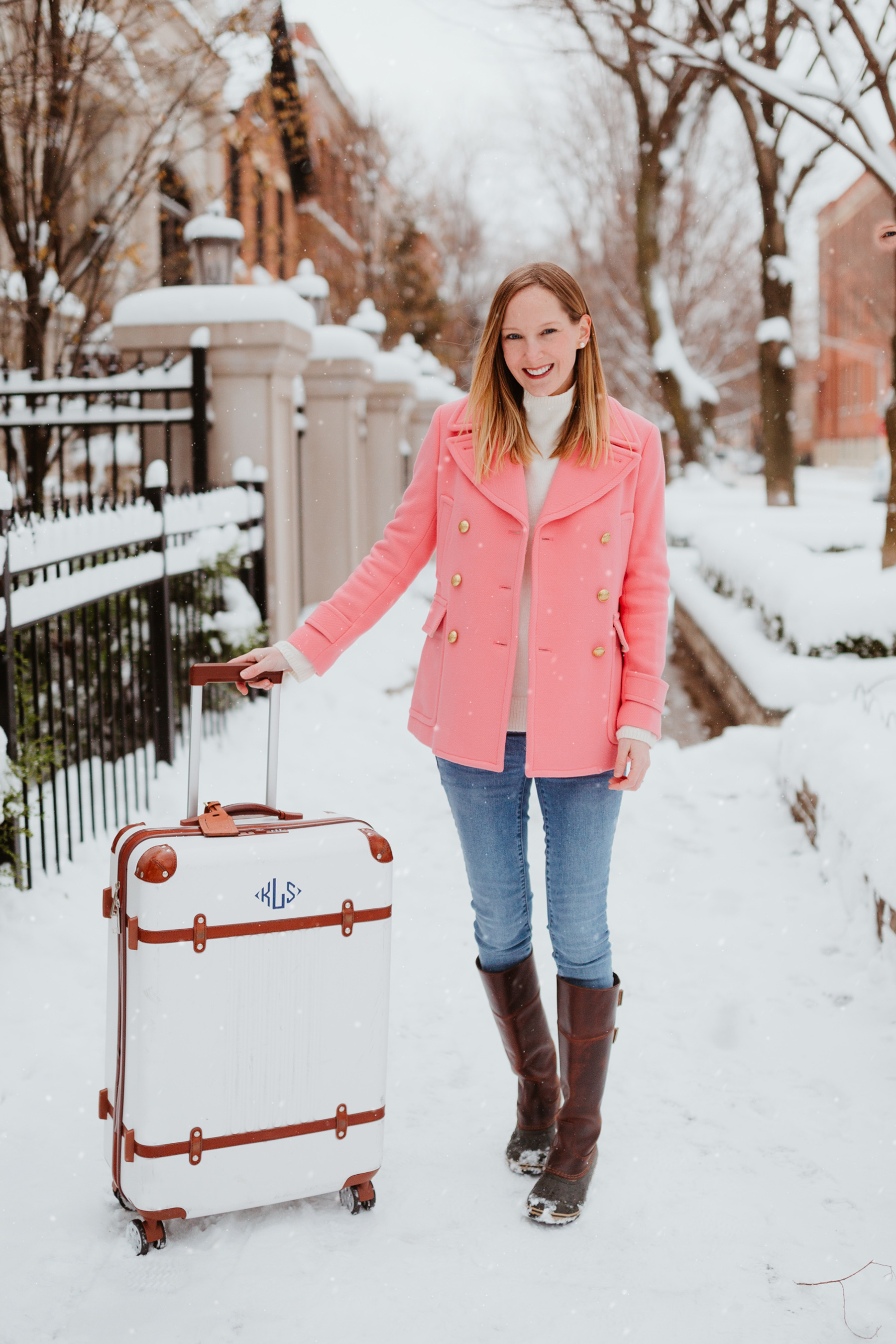 Old J.Crew Peacoat (My exact one is the Majesty, but there are a ton of brand new ones still available. Looking for a cute pink coat that's in stock?! Try this one! OBSESSED, and it's on sale!) / Mark & Graham Terminal One Suitcase /Sorel Slimpack Boots c/o (Also available here and here.) /Gap Soft Wear Skinny Jeans (Favorite non-maternity pair and favorite maternity version, which I'm wearing!)