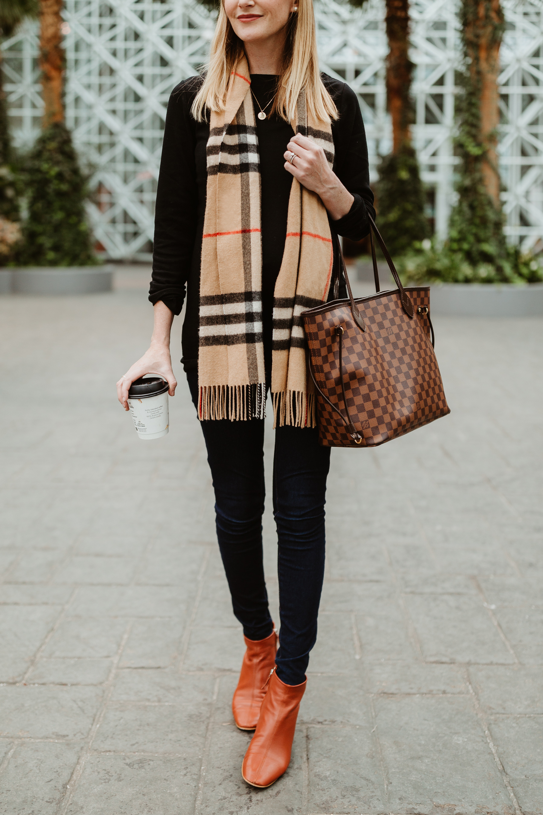 "Kelly's Outfit: Everlane Day Boot c/o / Gold Initial Necklace / Softest ""Modern Boatneck"" Tee by Gap / Louis Vuitton MM Neverfull Tote / Burberry Scarf / Old Navy Rockstar Jeans"
