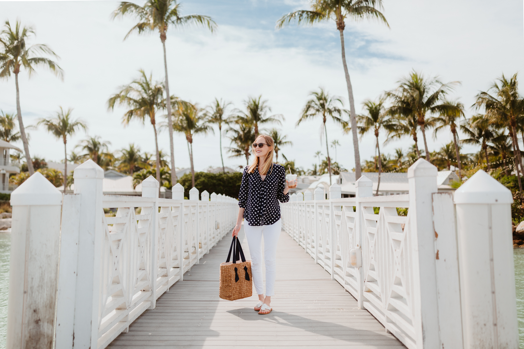 Kelly Larkin Outfit Details: J.Crew Navy Polka Dot Top / Pamela Munson Woven Tote / Jack Rogers / J Brand Maternity Ankle Jeans
