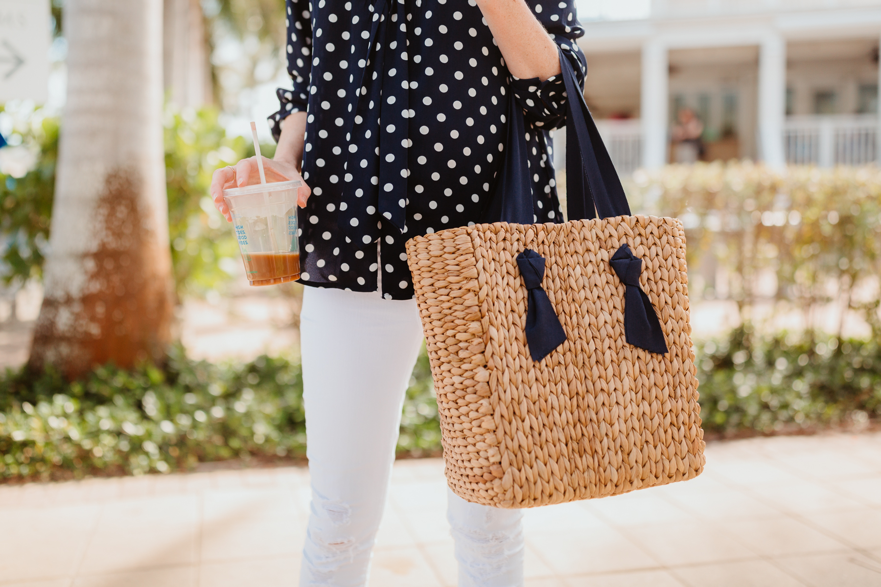 Kelly's Outfit: J.Crew Navy Polka Dot Top / Pamela Munson Woven Tote / J Brand Maternity Ankle Jeans