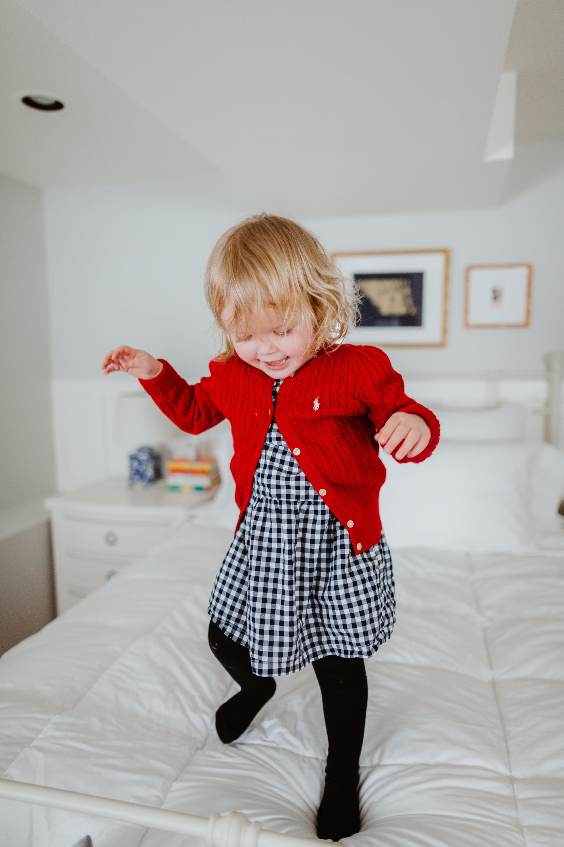 Emma Larkin jumping over  the oversized, extra-warm down comforter - The Company Store - White Sale