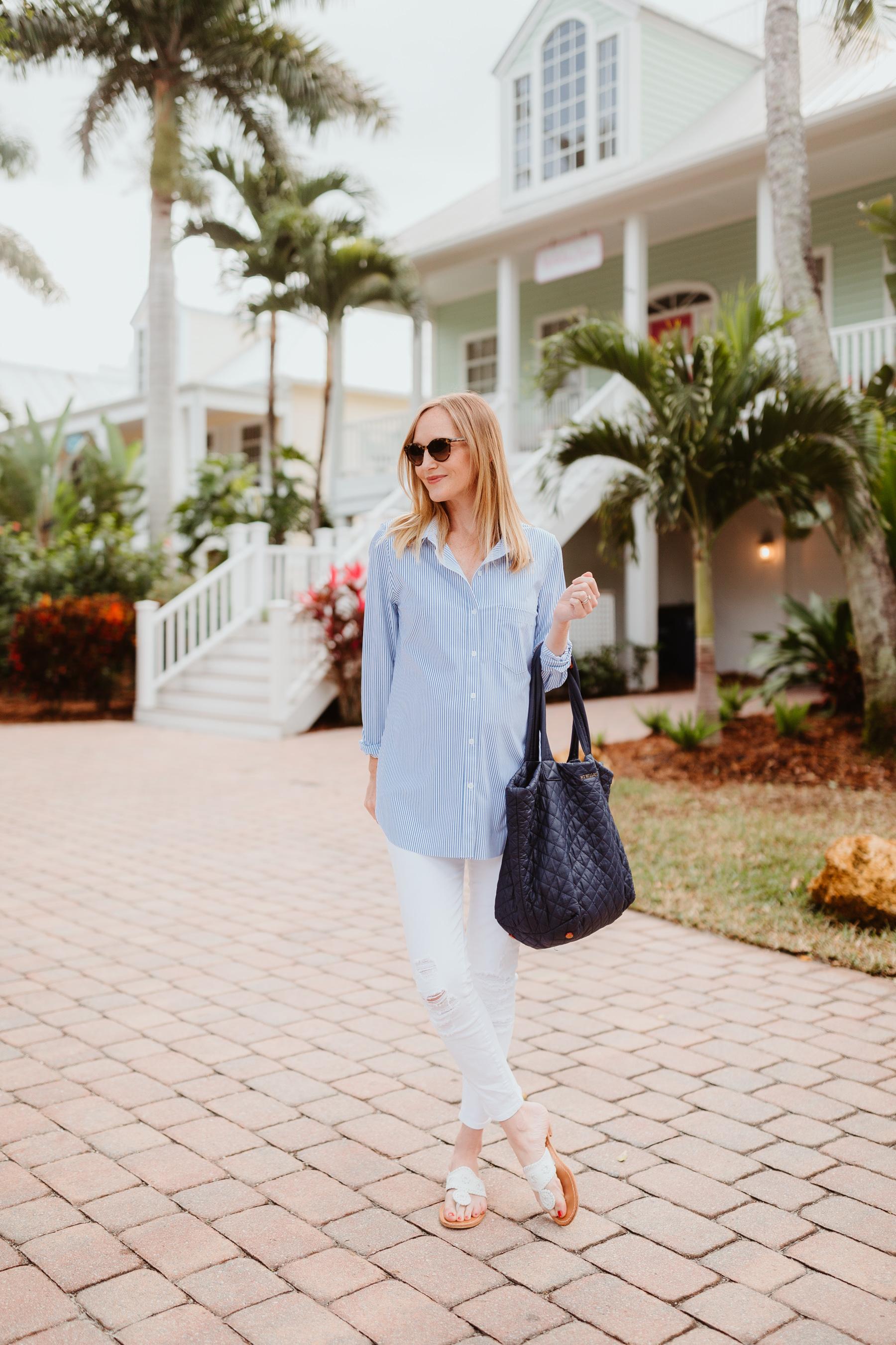 Kelly Larkin is wearing a LYSSÉ Schiffer Shirt/J Brand Maternity Ankle Jeans / MZ Wallace Tote