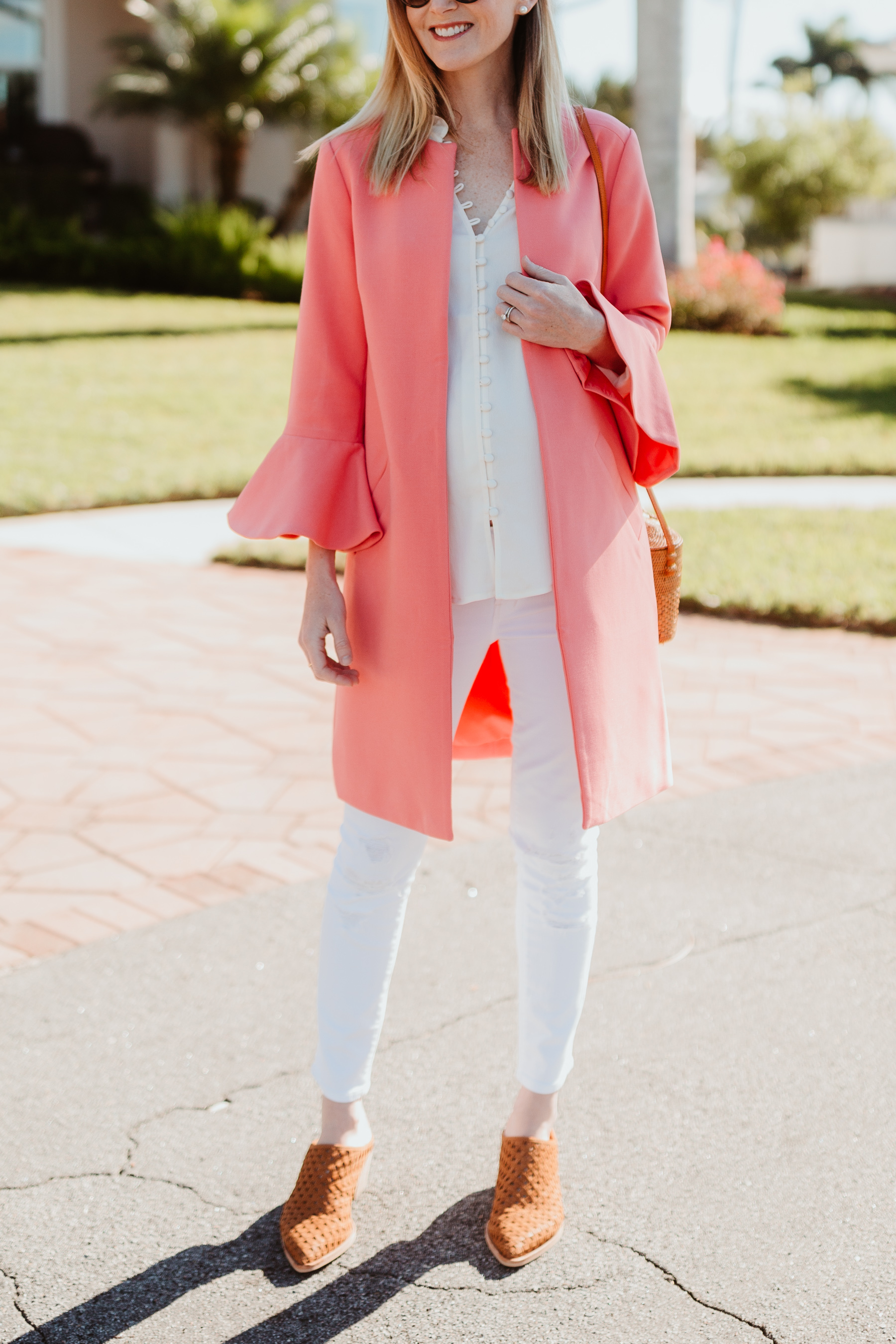 Kelly's Outfit: Pink Double Weave Flutter Sleeve Coat / Ruffled Button Blouse / Dolce Vita Sayer Mules / Newer Woven Crossbody Bag / Maternity Jeans