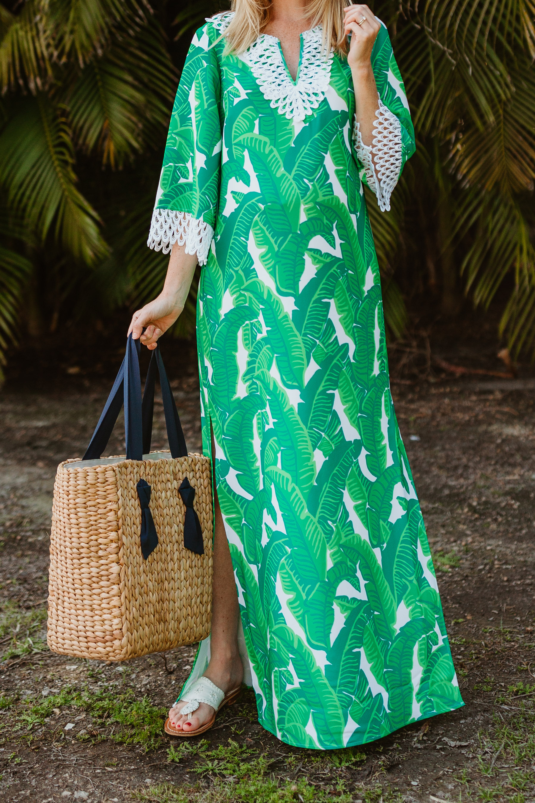 Kelly is wearing a Sail to Sable Banana Leaf Palm Maxi Dress / Jack Rogers / Pamela Munson Woven Tote