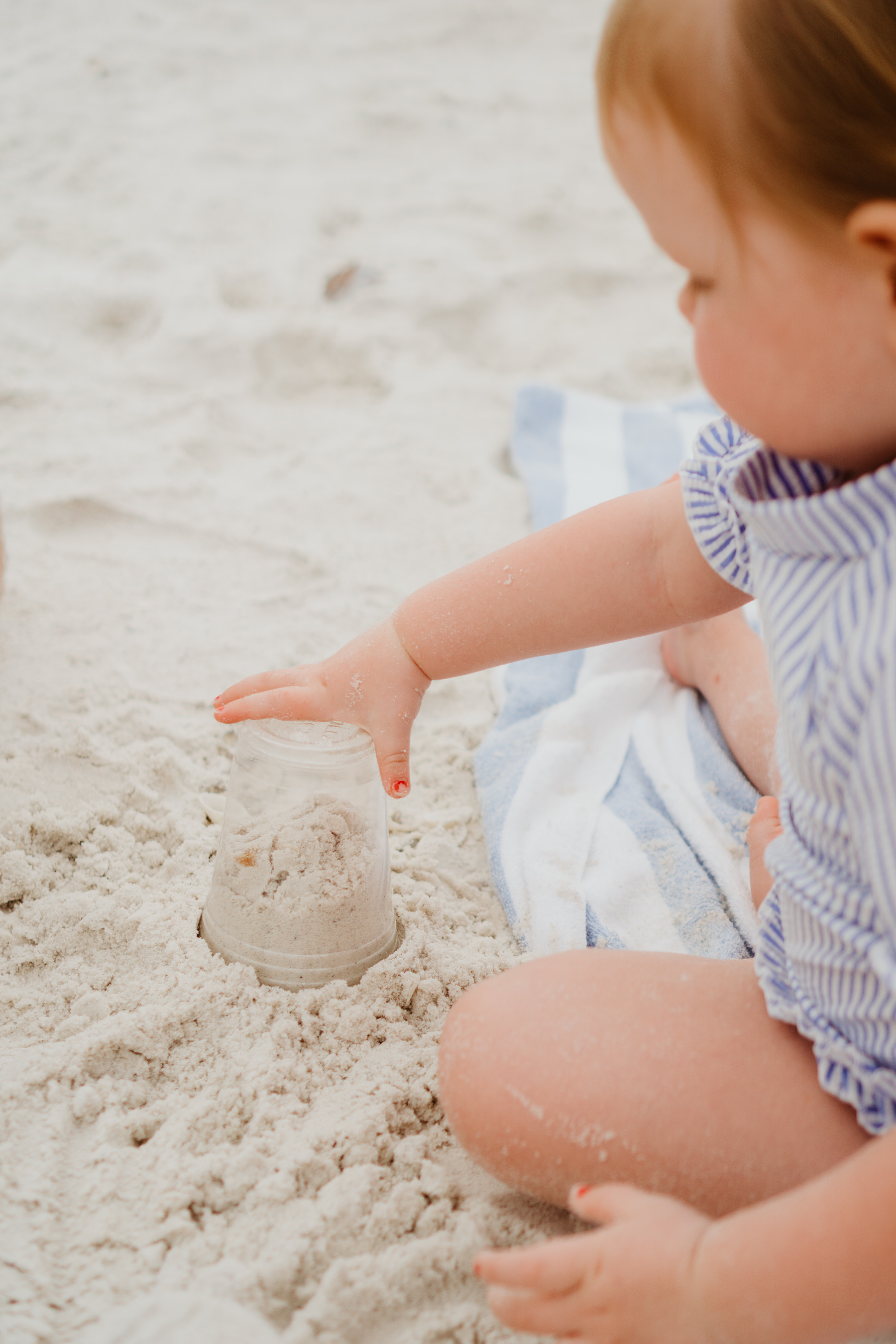 Emma playing with sand