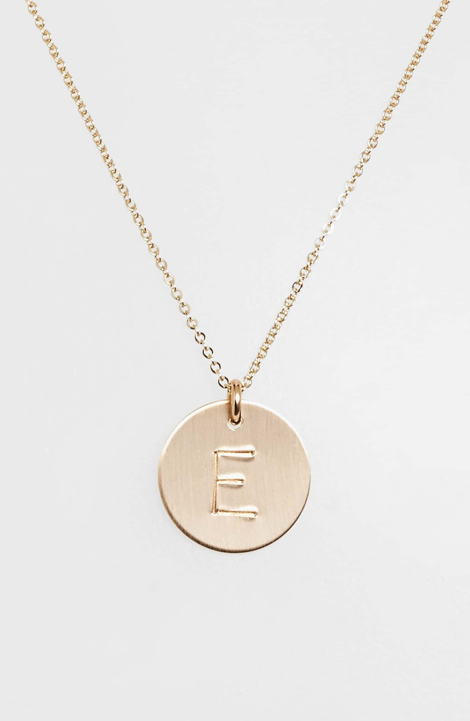 Nashelle's gold initial necklace