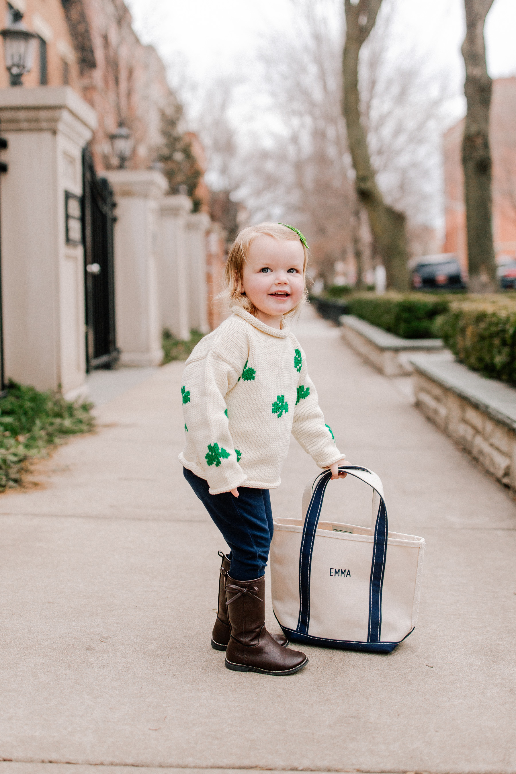 Emma's Outfit: Claver Shamrock Sweater / L.L. Bean Tote c/o / Gap Kids Jeggings and Boots / Little Makes Big Bow c/o