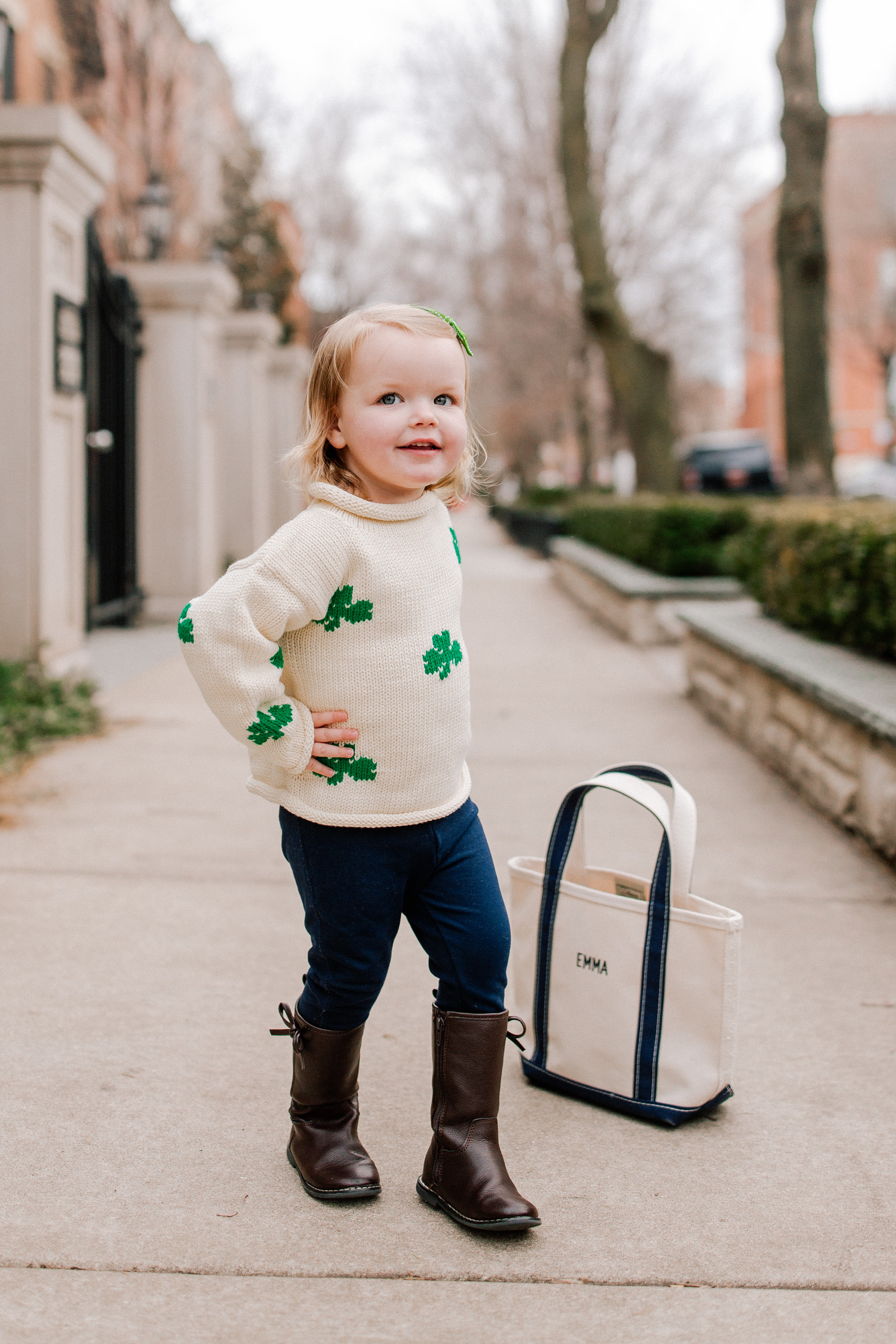 Emma's Outfit: Claver Shamrock Sweater / L.L. Bean Tote c/o / Gap Kids Jeggings and Boots / Little Makes Big Bow