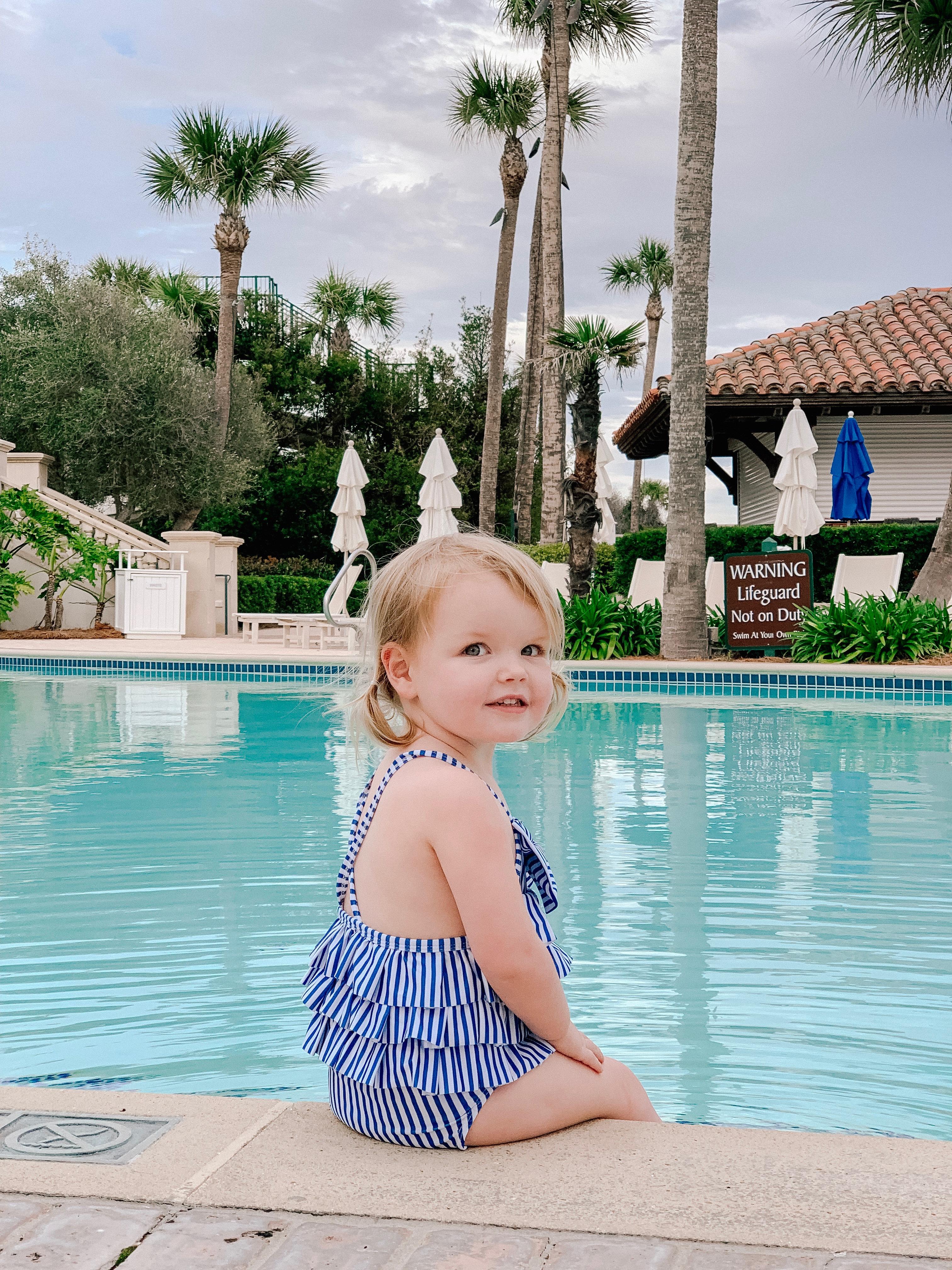 Emma's wearing a Striped Bathing Suit