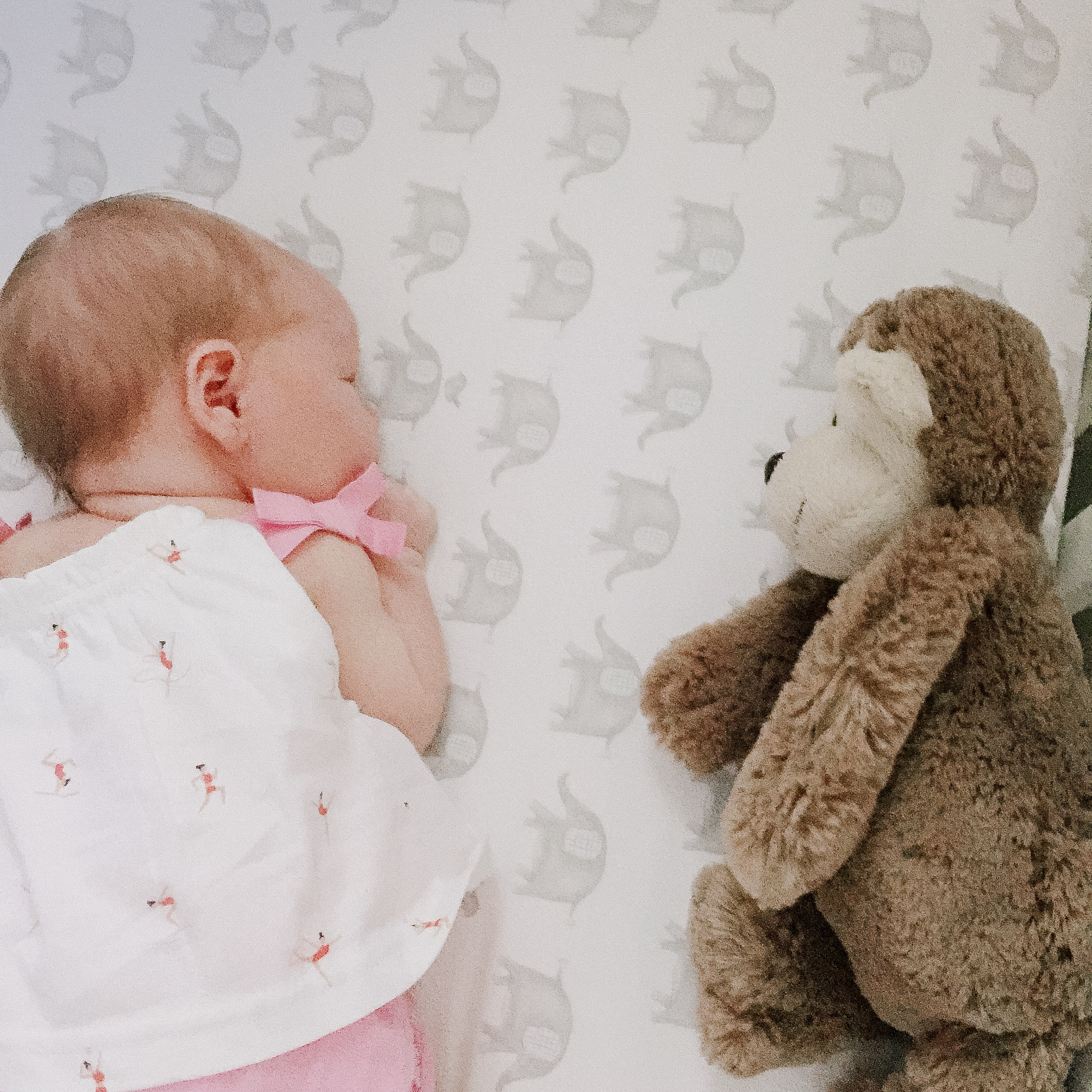 Baby Emma sleeping with a monkey toy