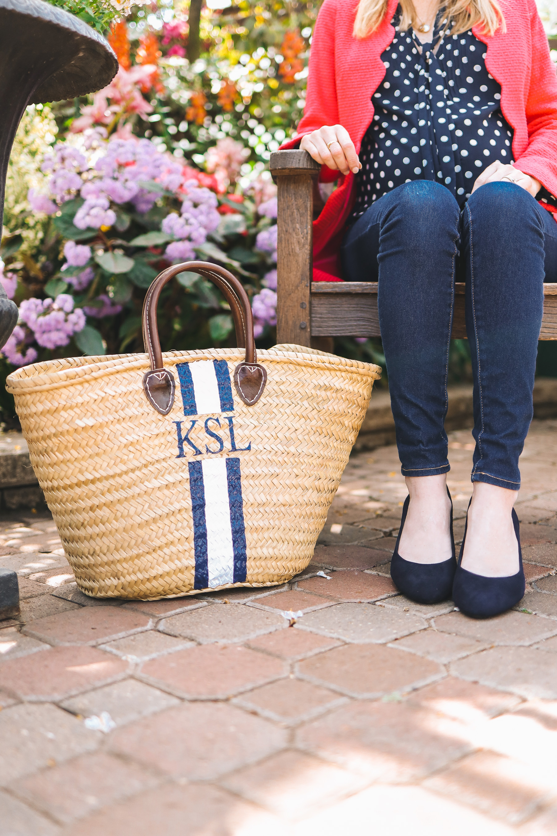 Kelly Larkin's outfit details: Evolve Navy Pumps c/o / Mark & Graham Hand-Painted Tote