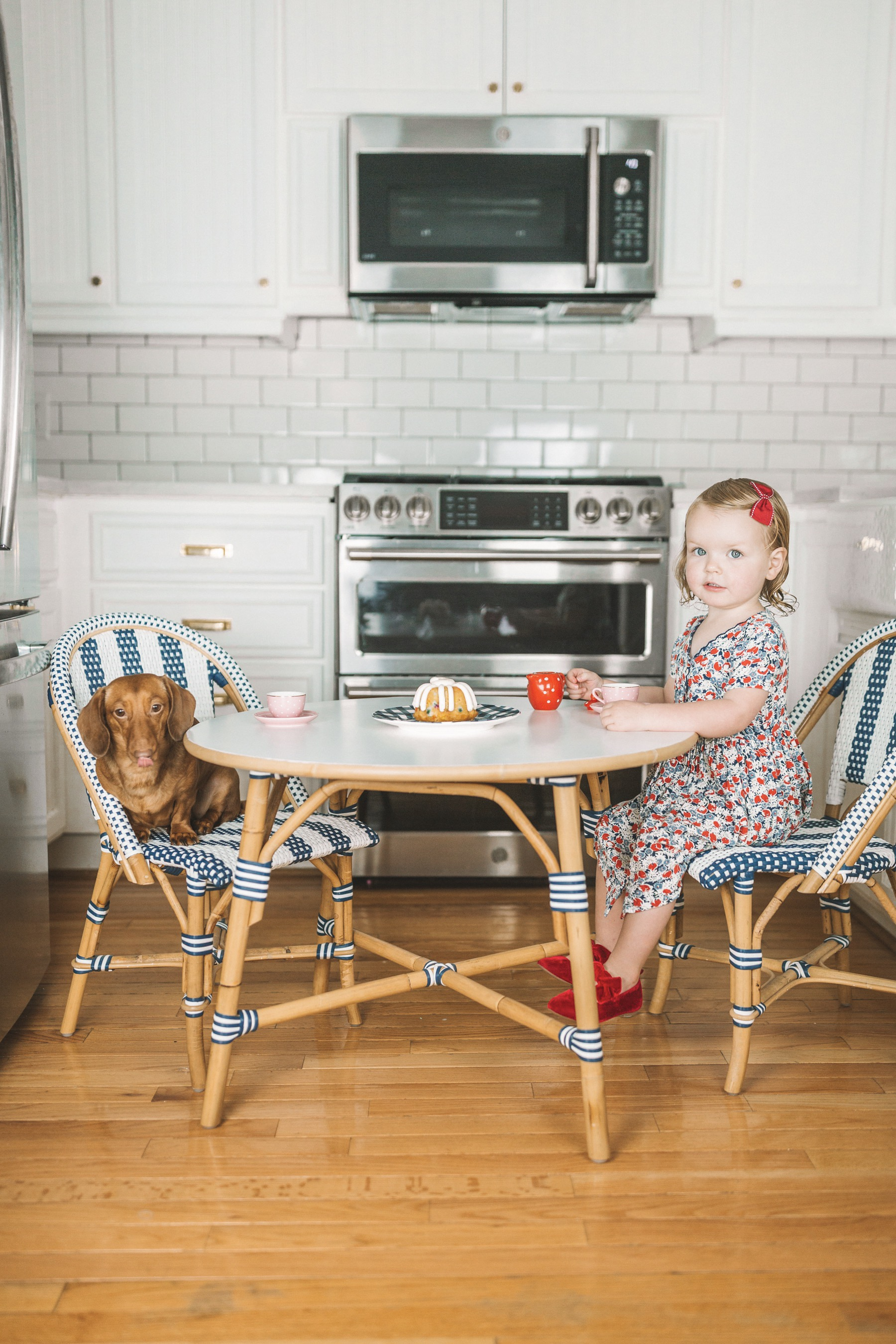 Picture details: Serena & Lily Riviera Kids' Table and Chairs c/o / Old Gap Kids Bow Flats / Newer Ralph Lauren Dress / Hair Bows