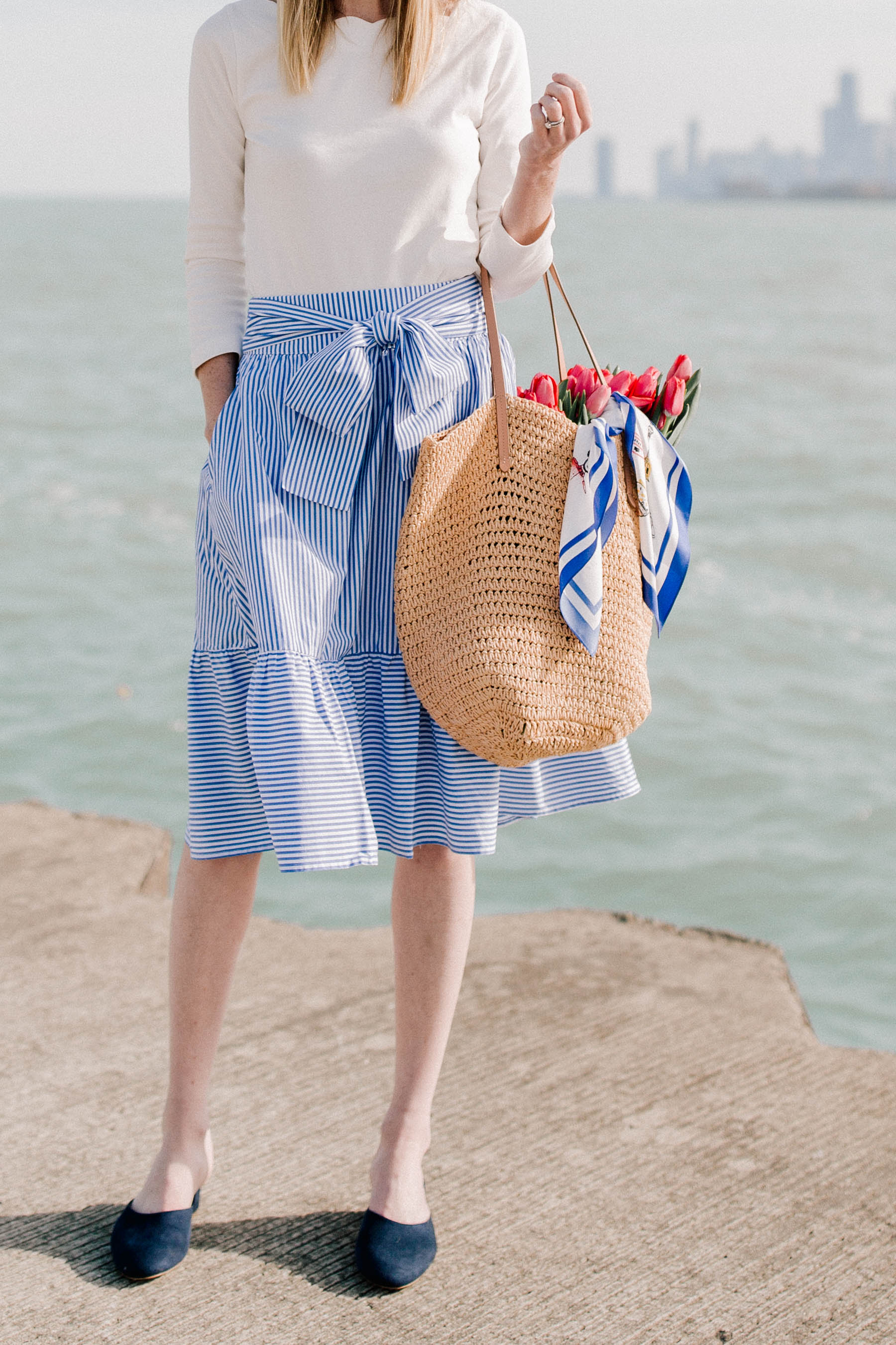Kelly's look: J.Crew Factory Skirt /  Navy Mules / Newer Woven Tote / Scalloped Top