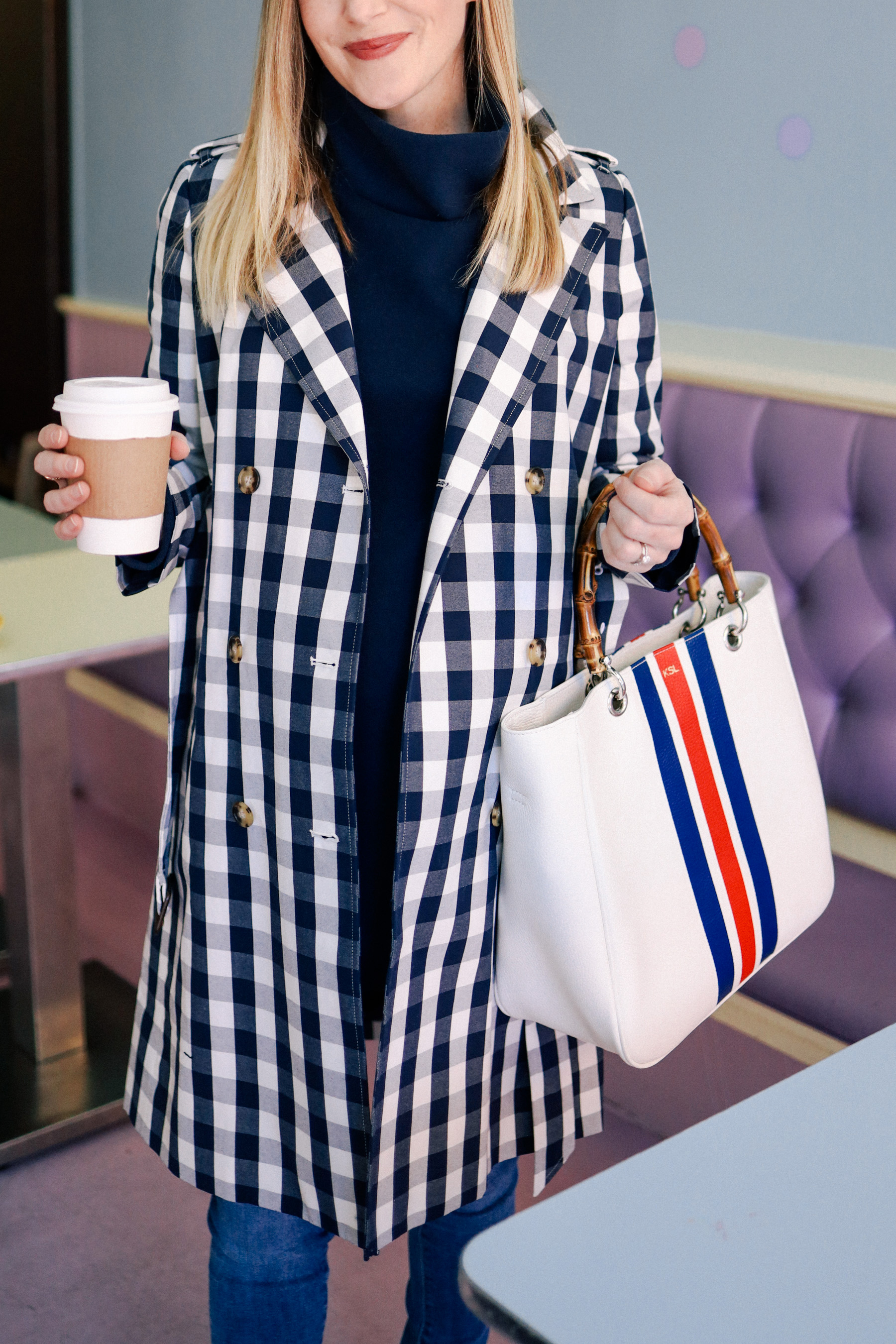 Kelly is wearing a J.Crew Gingham Trench Coat