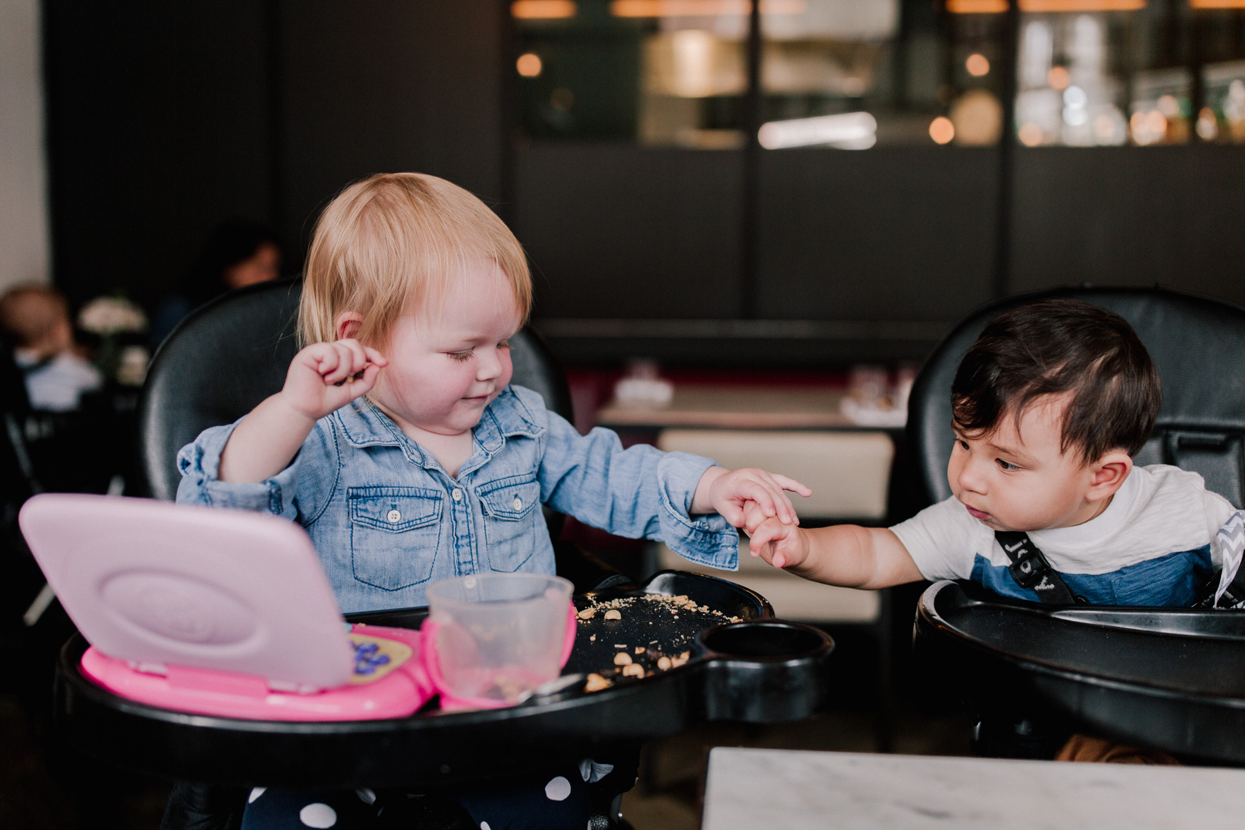 Emma and Zain. Yes, that's Emma slapping Zain's hand away from her snacks.