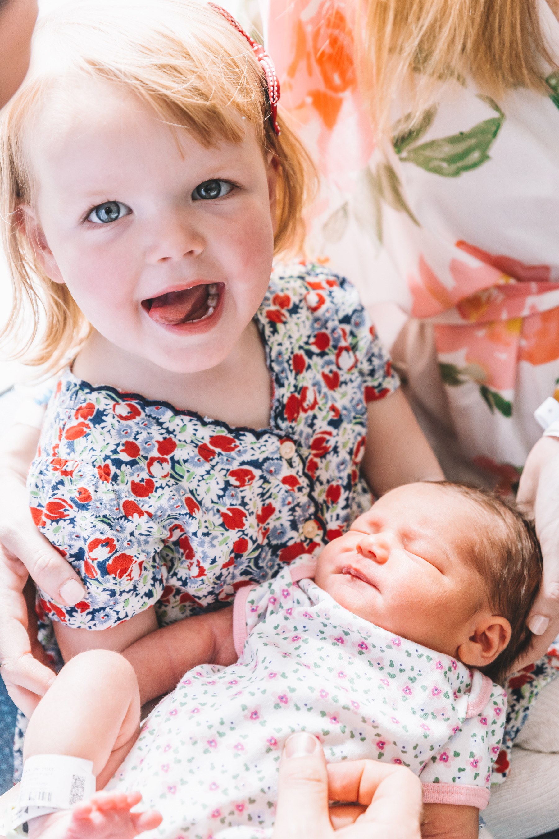 Emma is holding her sister Lucy Larkin