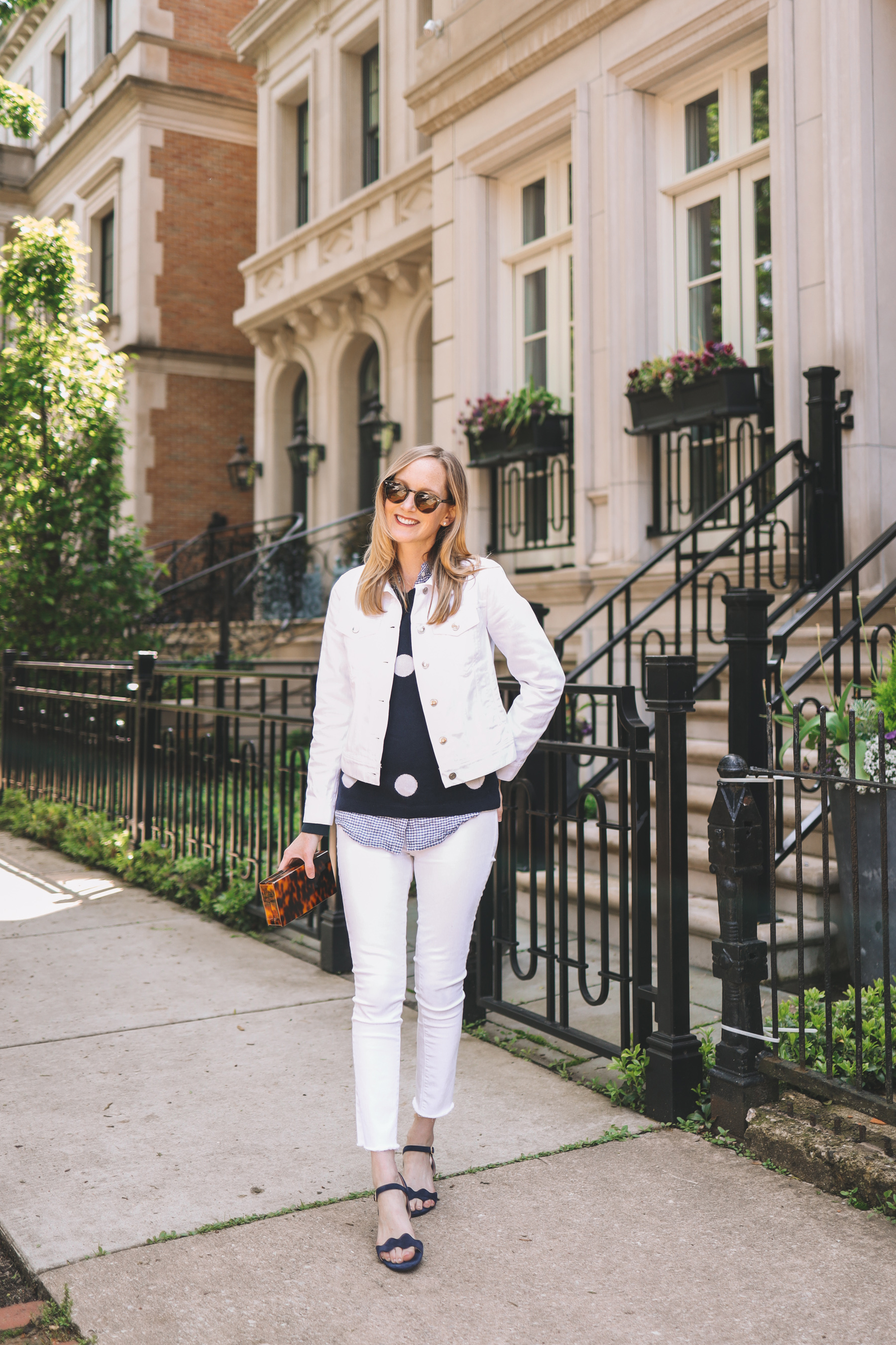 Kelly Larkin's outfit details: Patricia Green Scalloped Sandals/ Tortoise Clutch / Favorite White Jeans / Navy Polka Dot Sweater / Tortoise Clutch / Gingham Button-Down