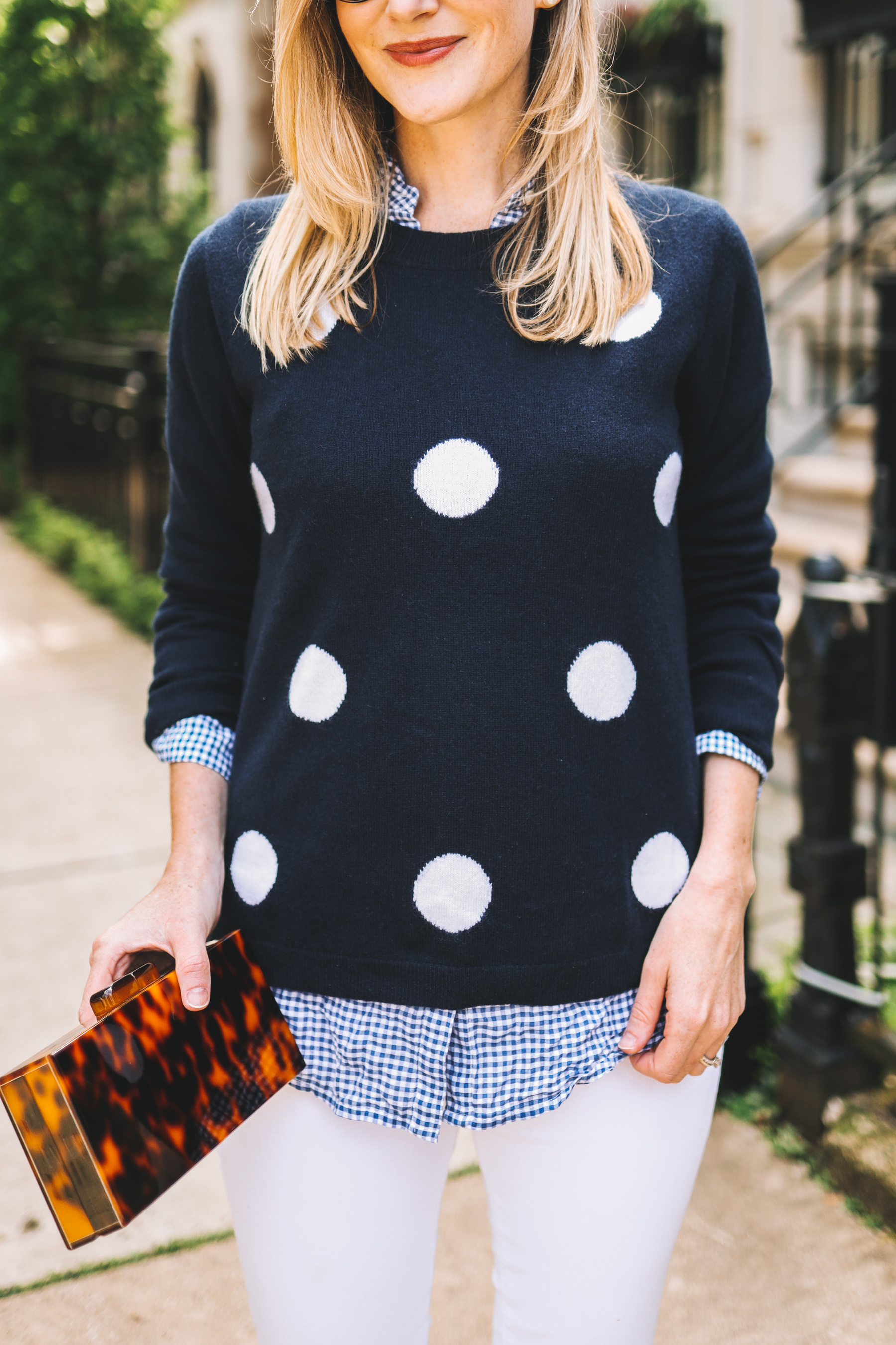 Kelly Larkin's outfit details: Tortoise Clutch / Favorite White Jeans  / Navy Polka Dot Sweater / Tortoise Clutch / Gingham Button-Down