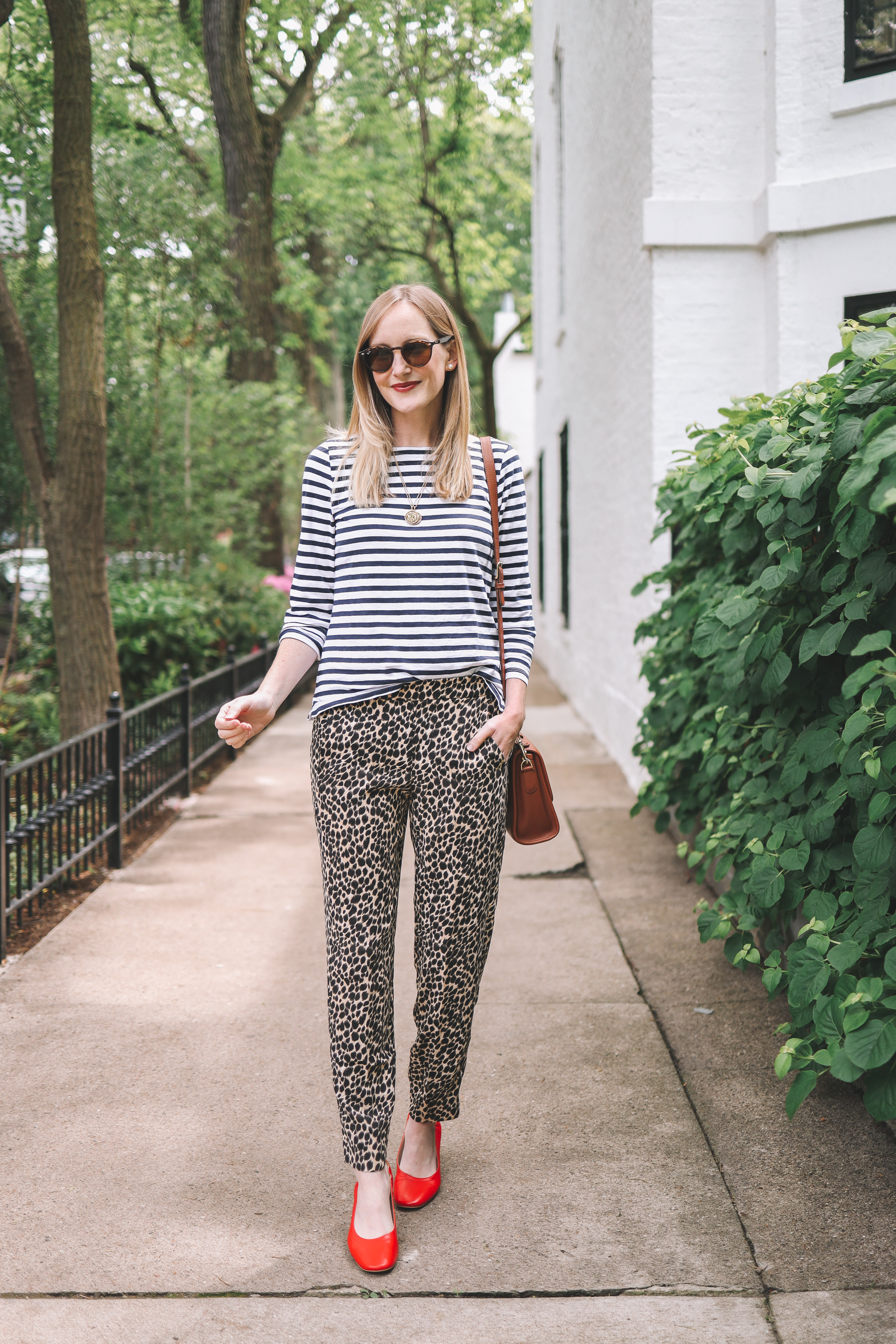 Kelly Larkin's outfit details: J.Crew Factory Pull-On Leopard Jamie Pants / Everlane Day Heels / J.Crew Striped Tee / Crossbody / Maxi-Cosi Carrier