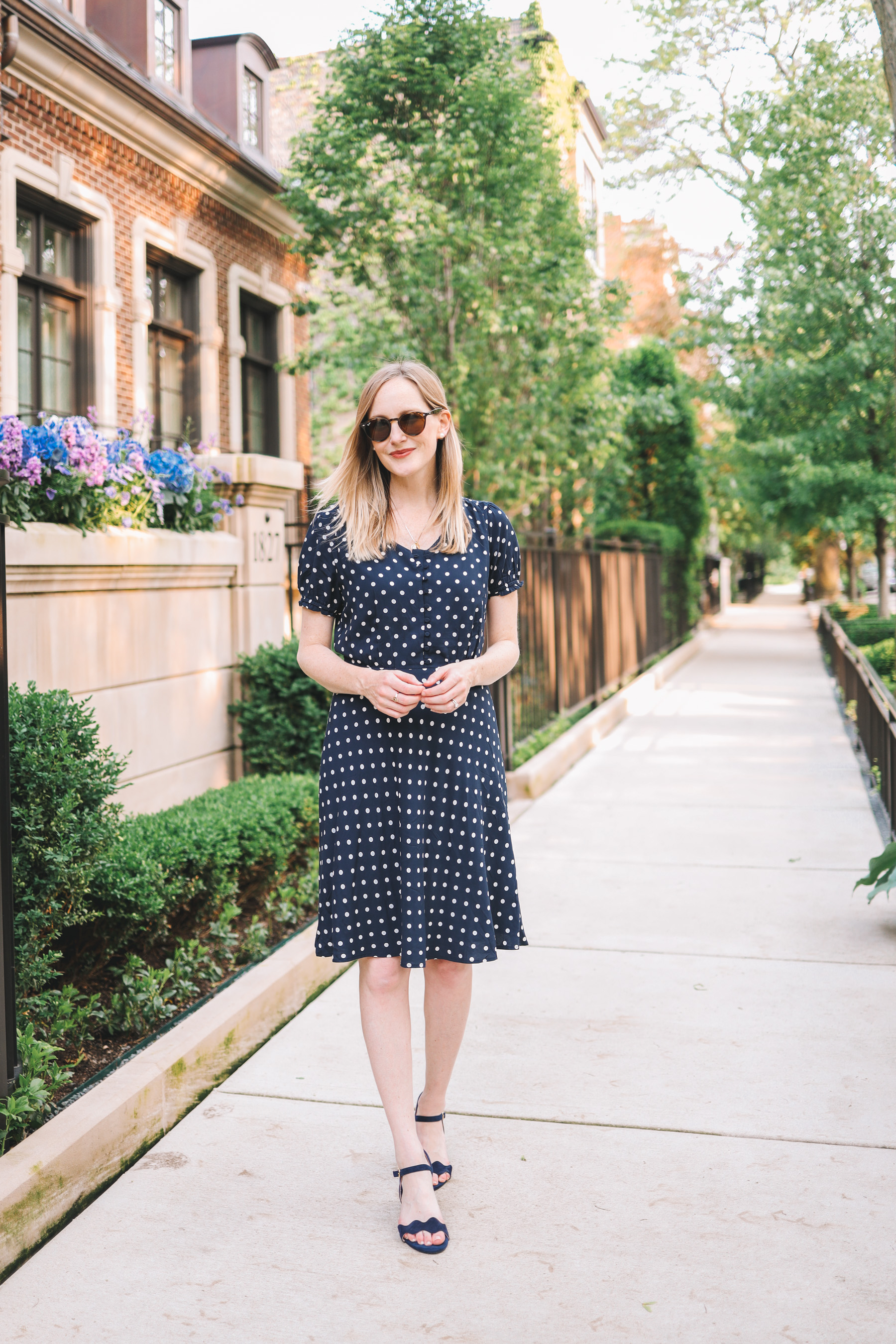 Kelly Larkin's outfit details: Navy Polka Dot Dress / Patricia Green Scalloped Sandals/ Stampled Initial Necklace