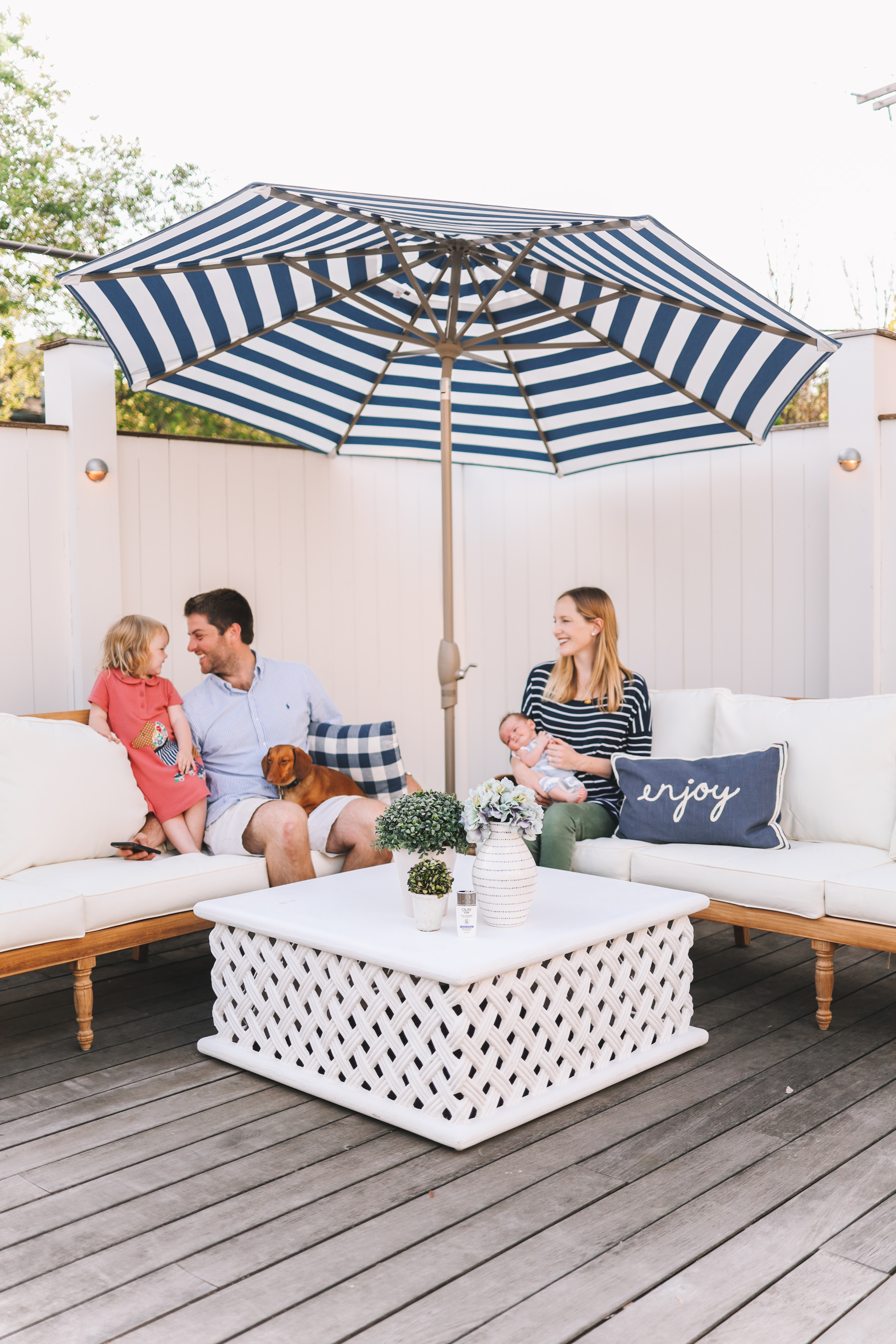 Happy family enjoying their preppy deck