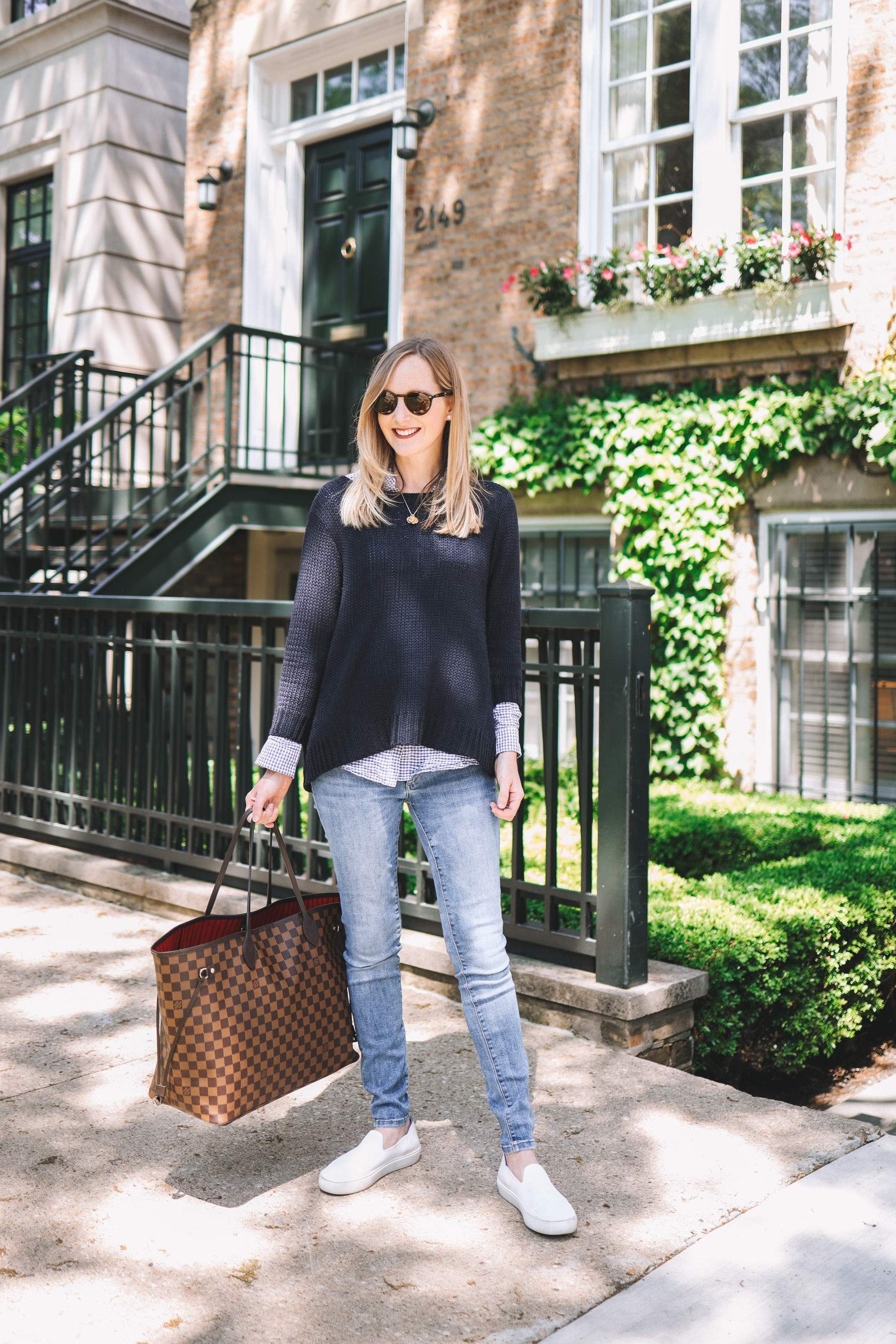 Kely's outfit details: Maternity Jeans / Rothy's Washable Sneakers / Tuckernuck Bow Sweater / J.McLaughlin Gingham Button-Down / Louis Vuitton Neverfull GM / Stamped Initial Necklace / Ray-Ban Sunglasses