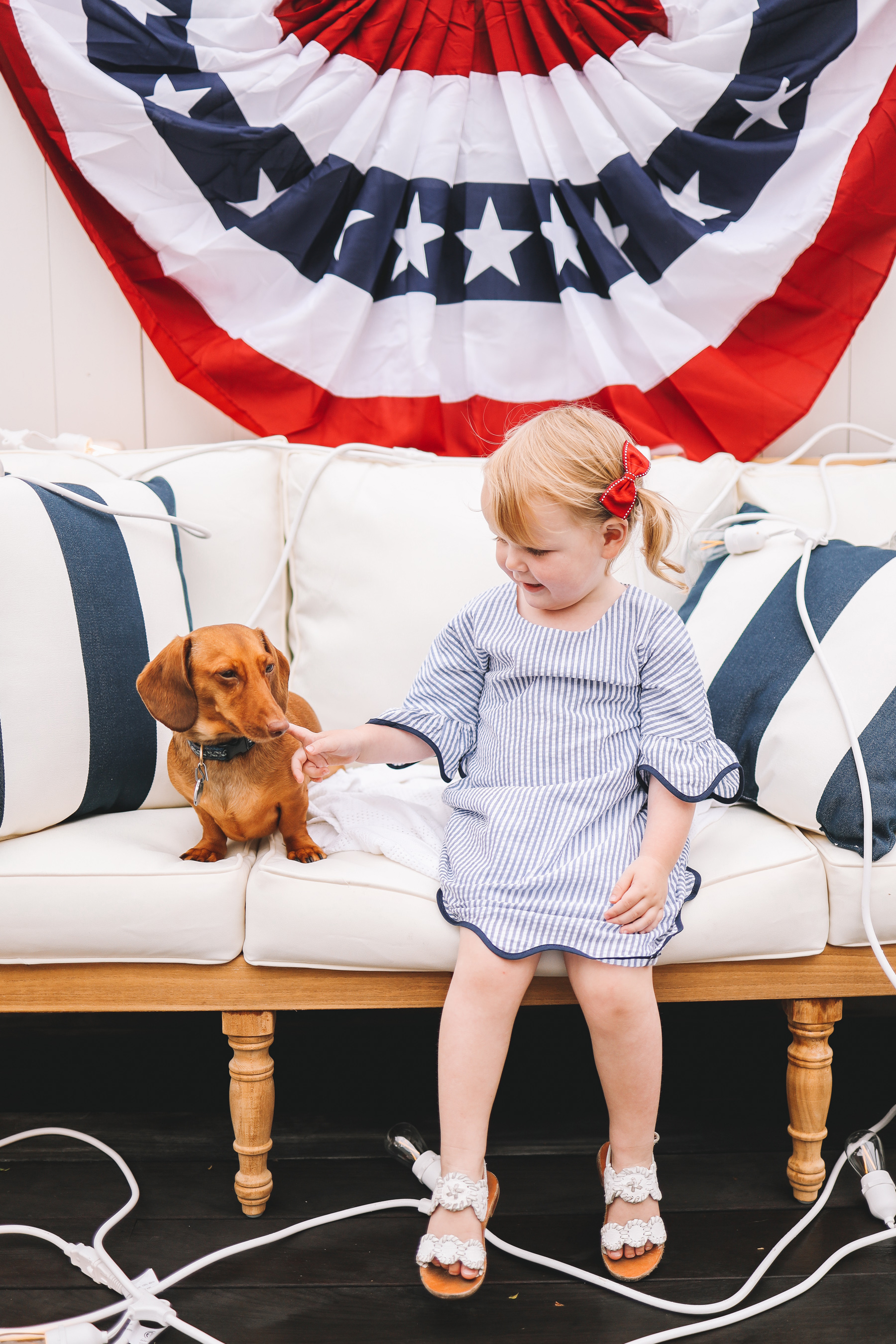 toddler and a dachshund dog