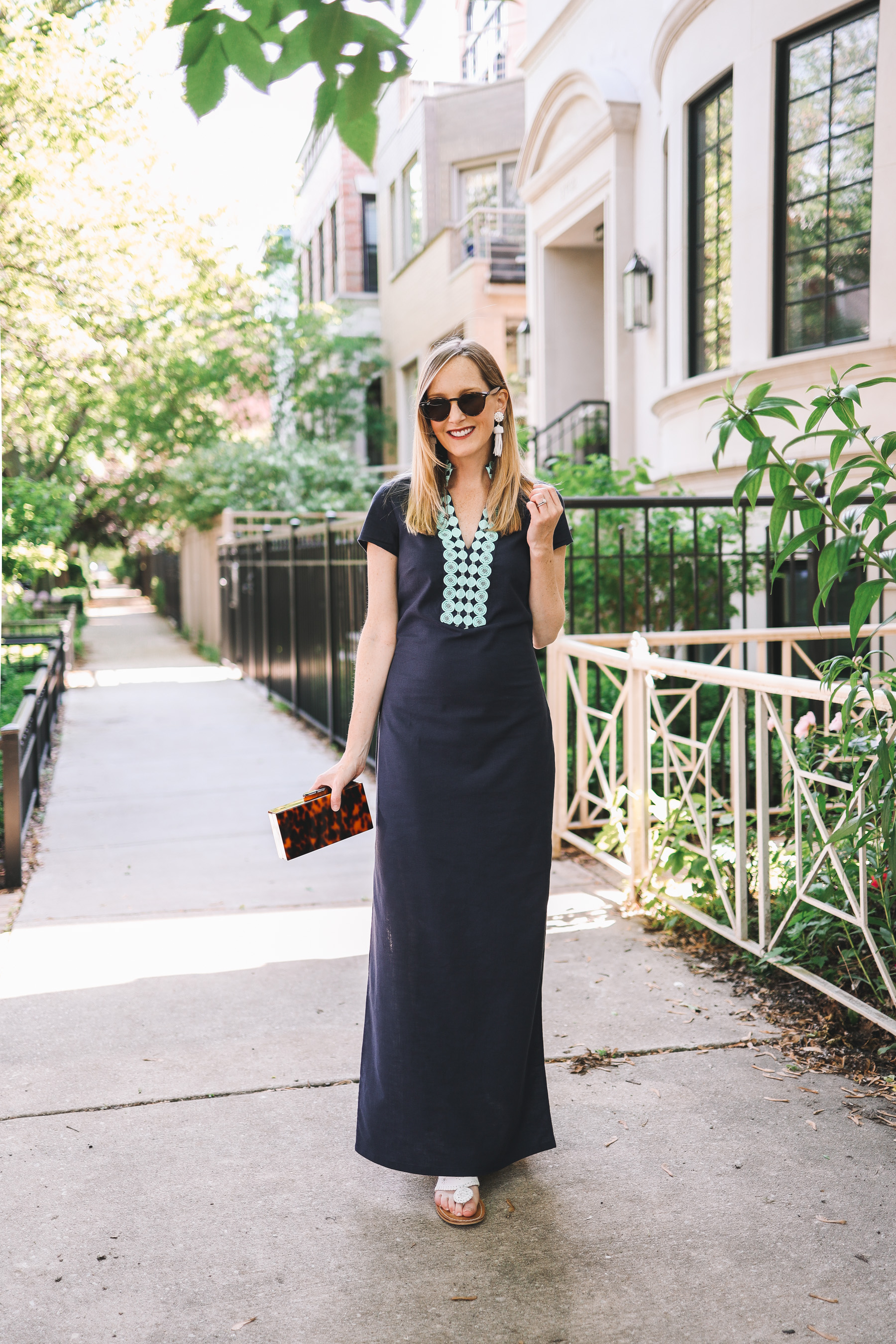 Kelly Larkin is wearing a Sail to Sable maxi dress