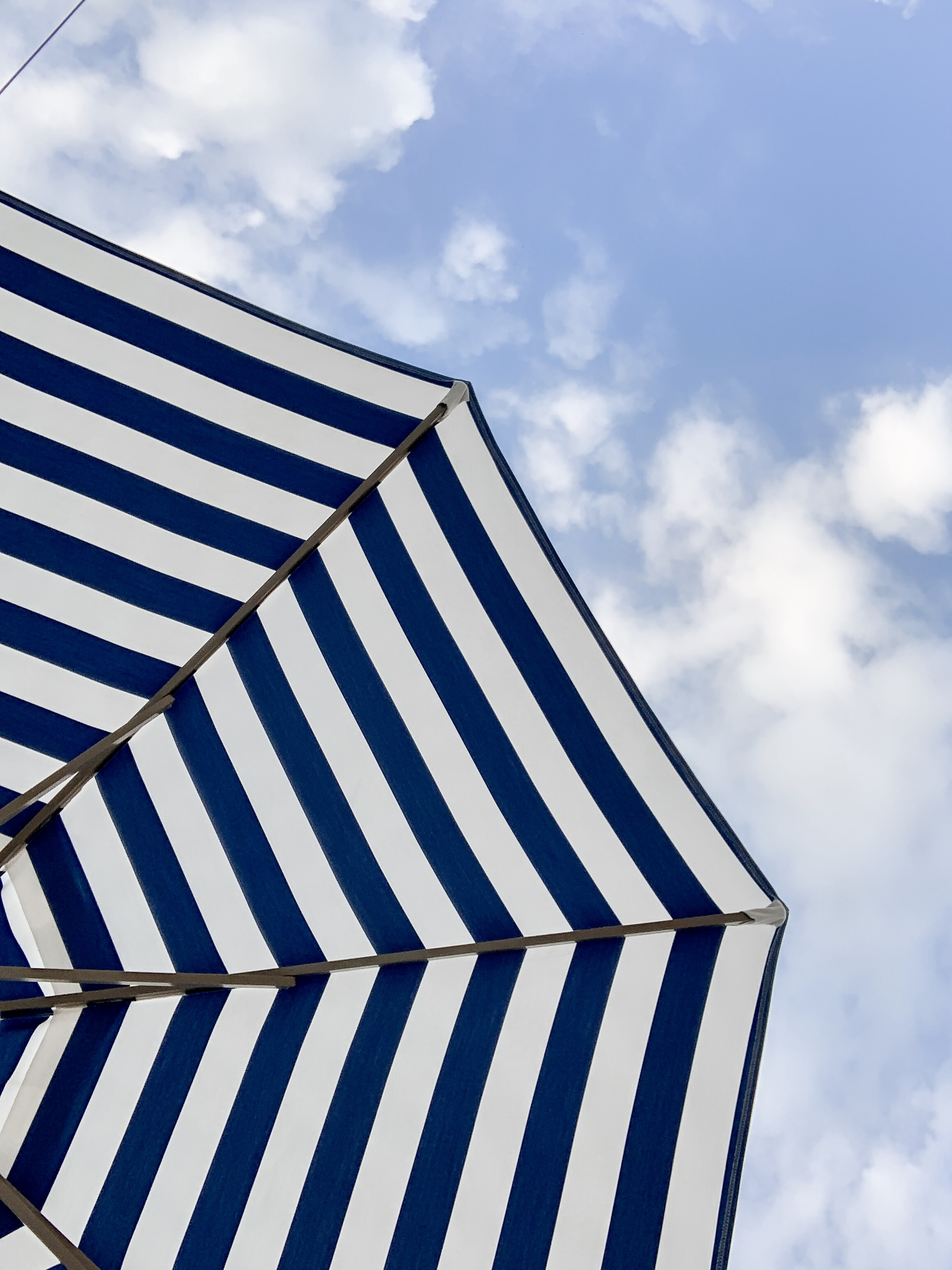 striped blue and white sun umbrella