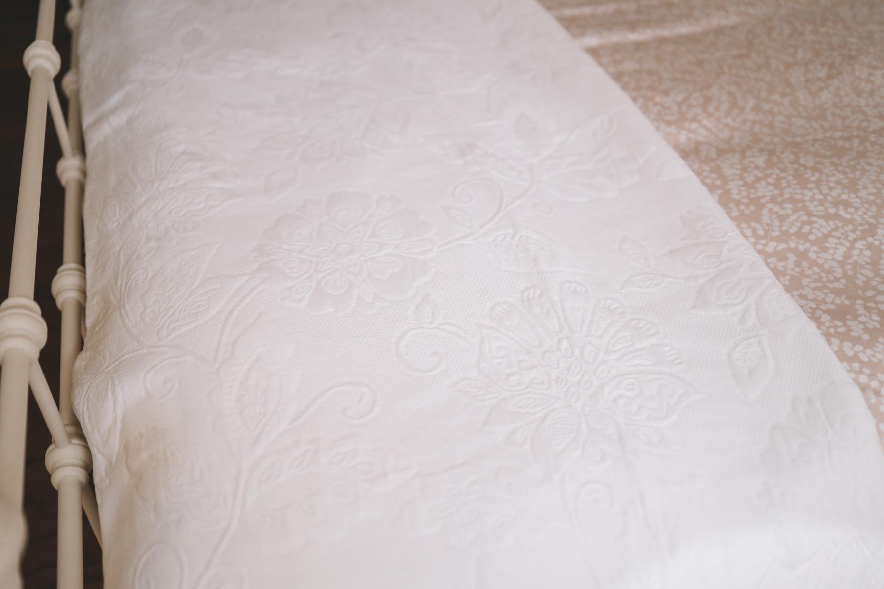 Birds-eye-view of white pillows on pink sheeds