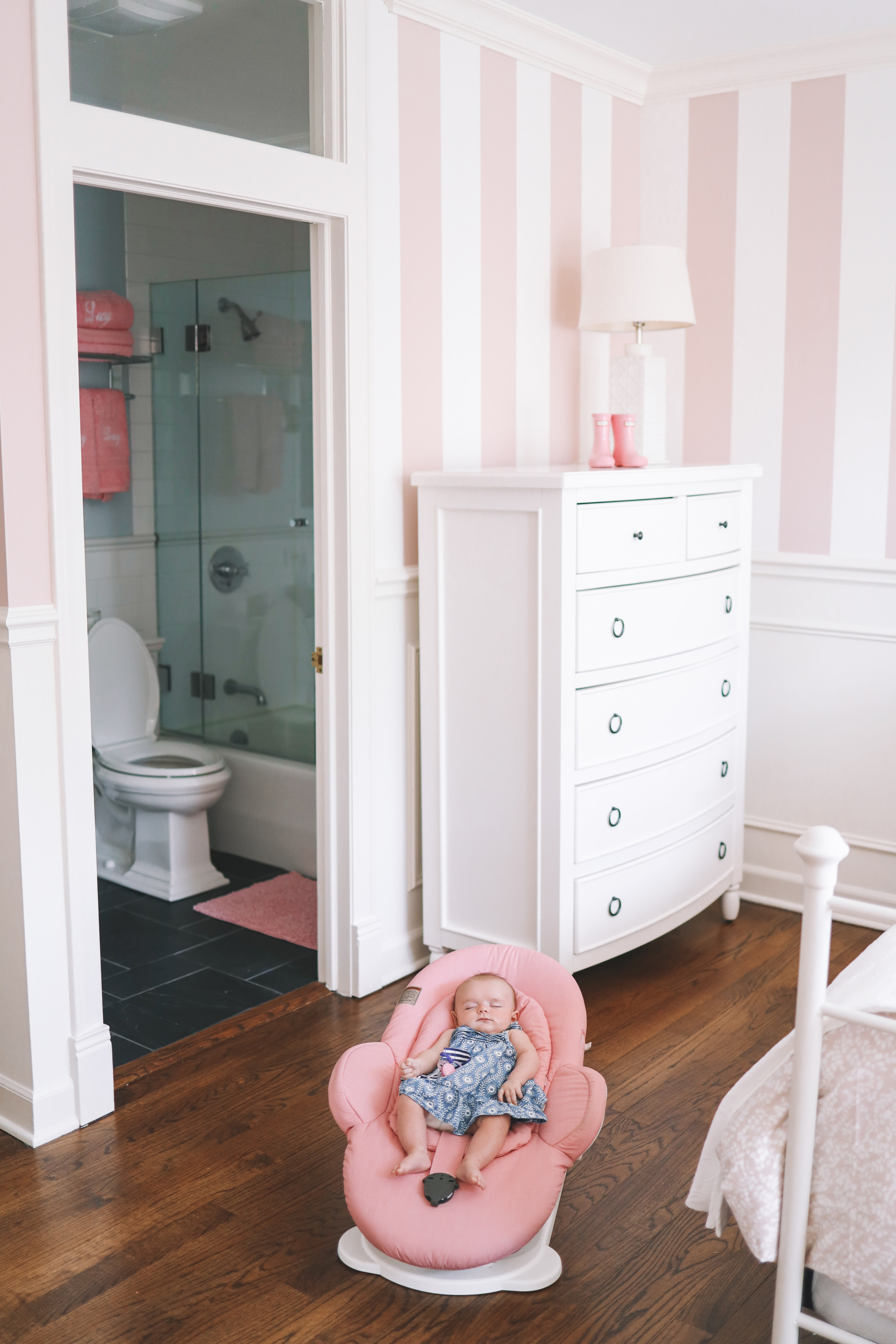 Preppy Girls Room - Lucy on the floor of her pink room, showing the decoration progress