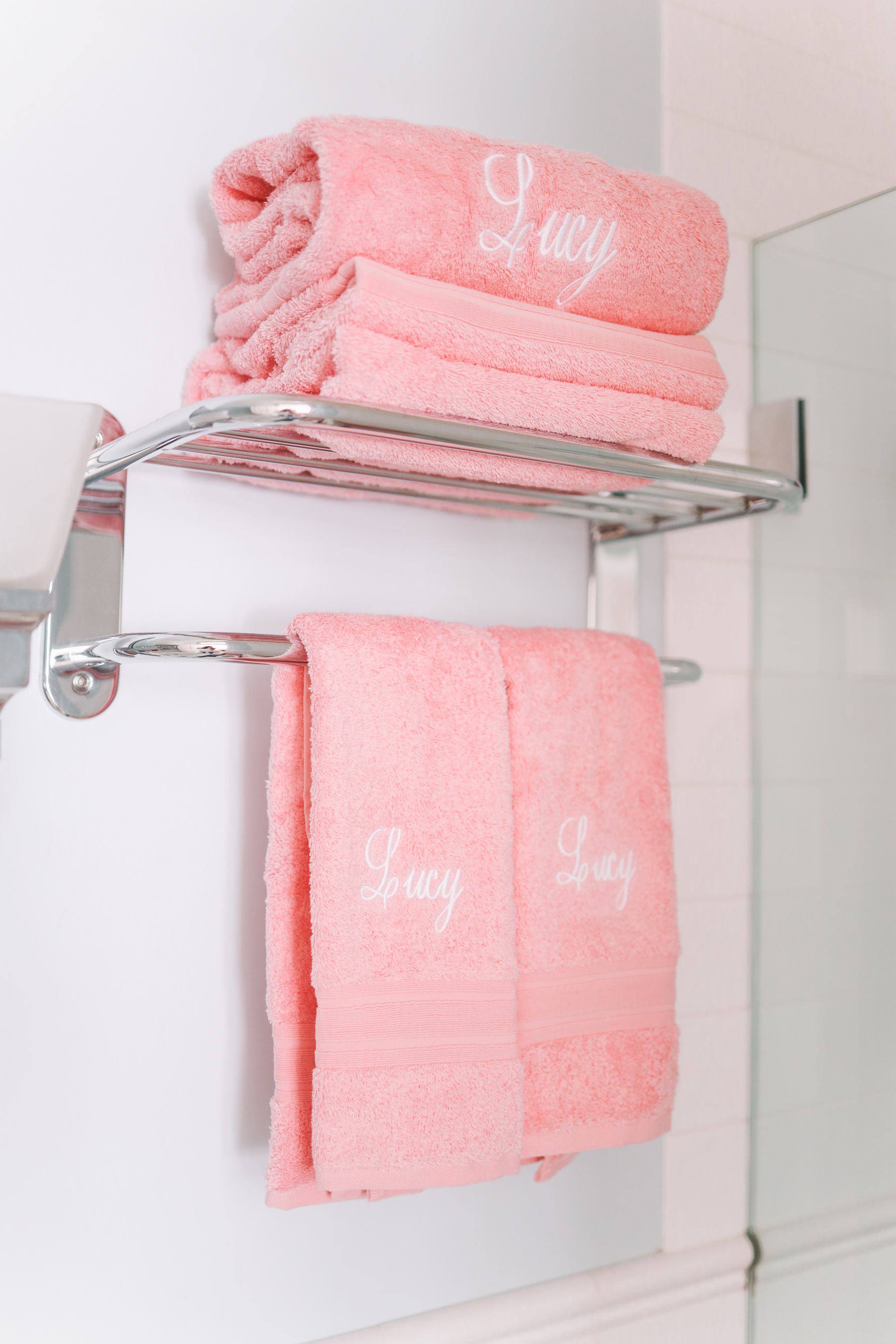 Monogrammed pink towels with the name Lucy