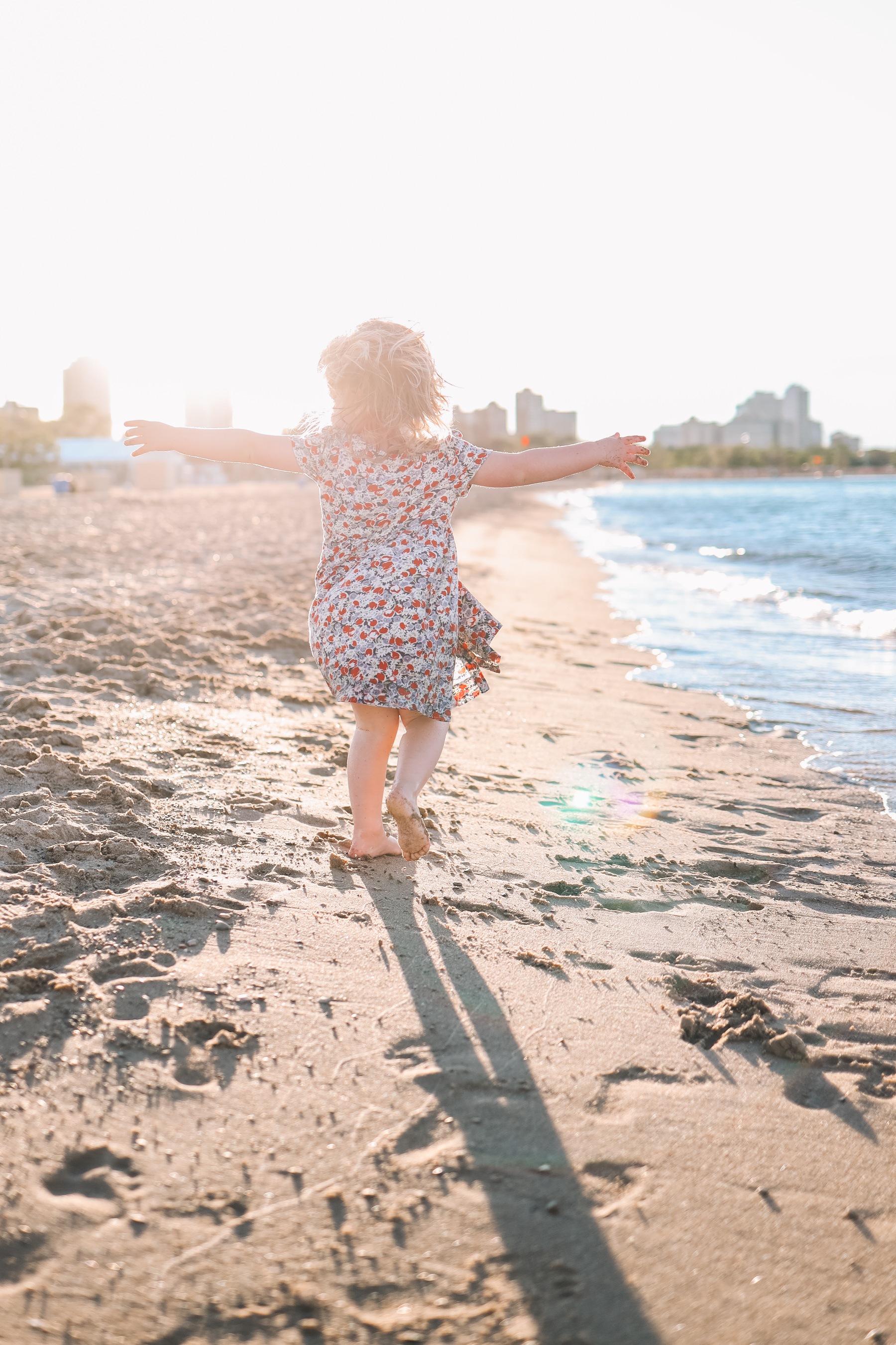 Emma is playing at the beach in Chicago