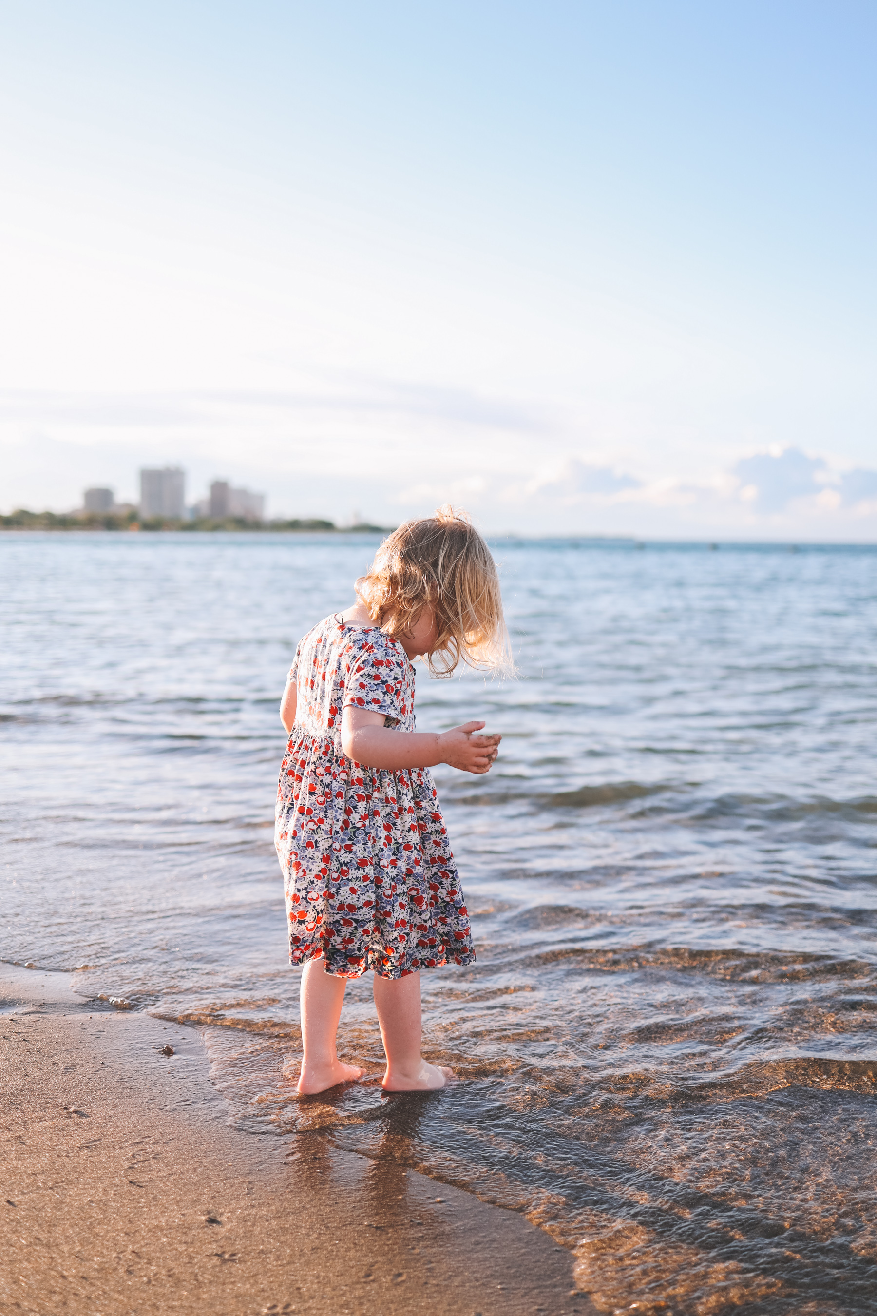 Girl is playing at the beach in Chicago