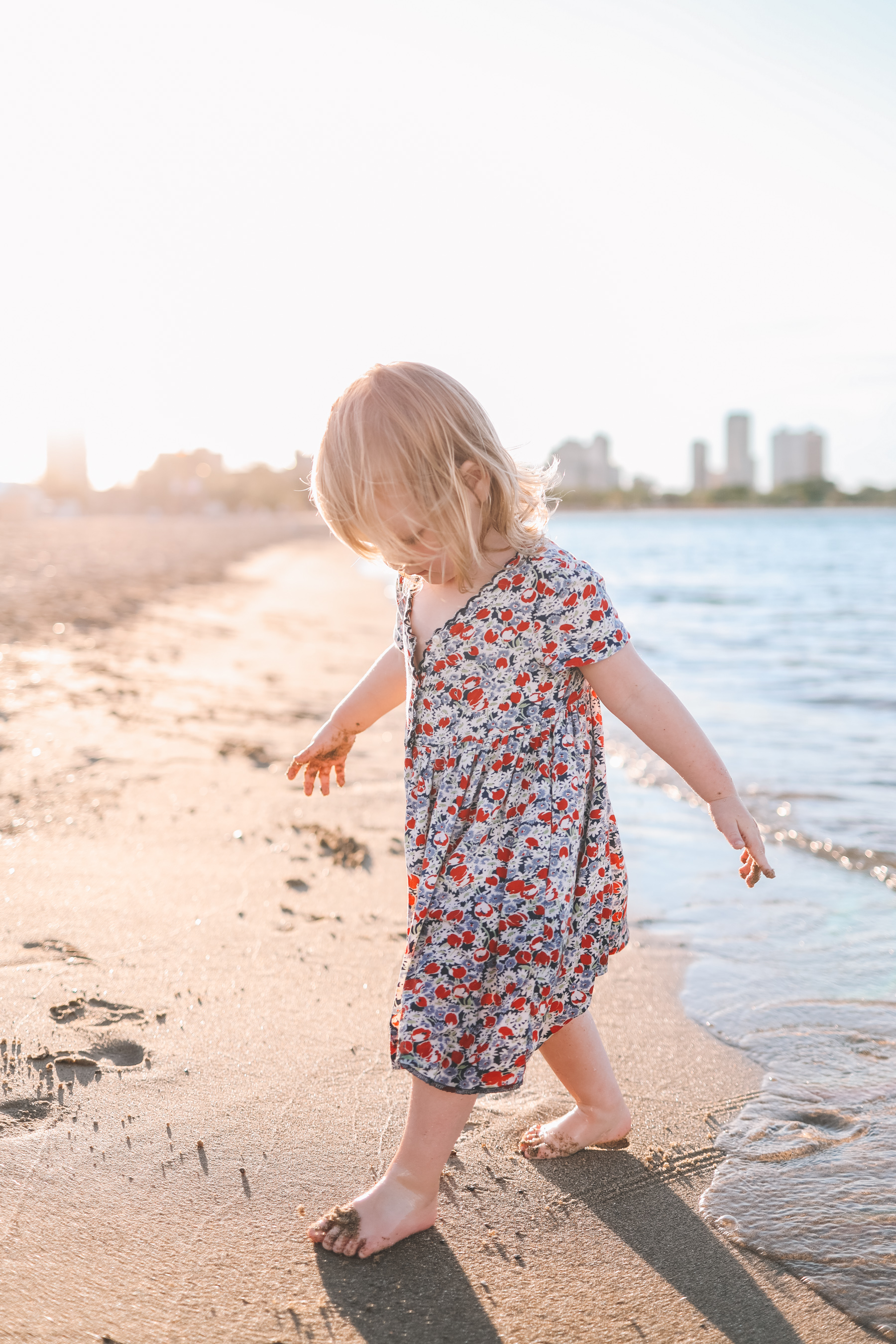 Girl is playing at the beach