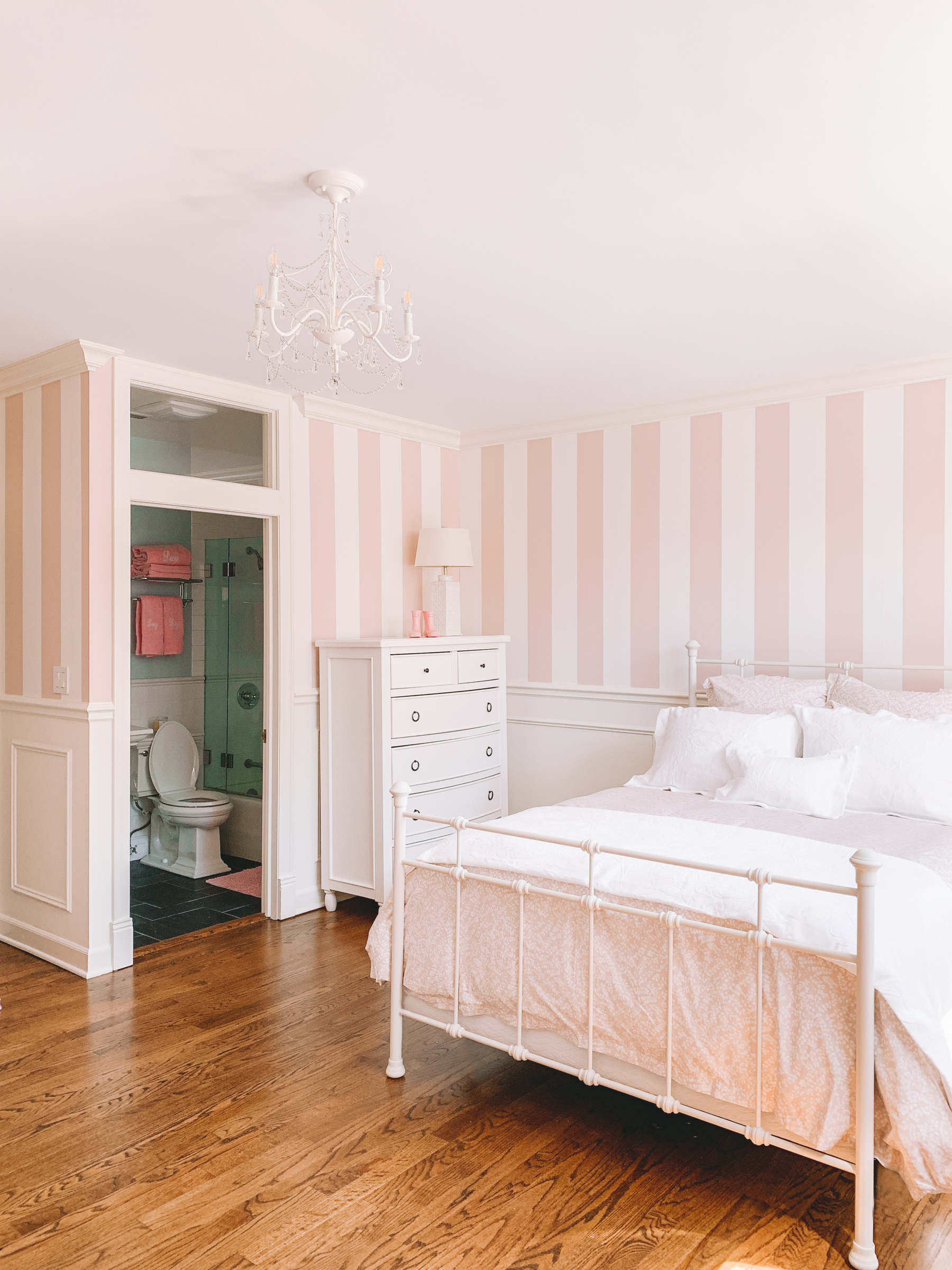 Side view of Lucy's pink and white baby room