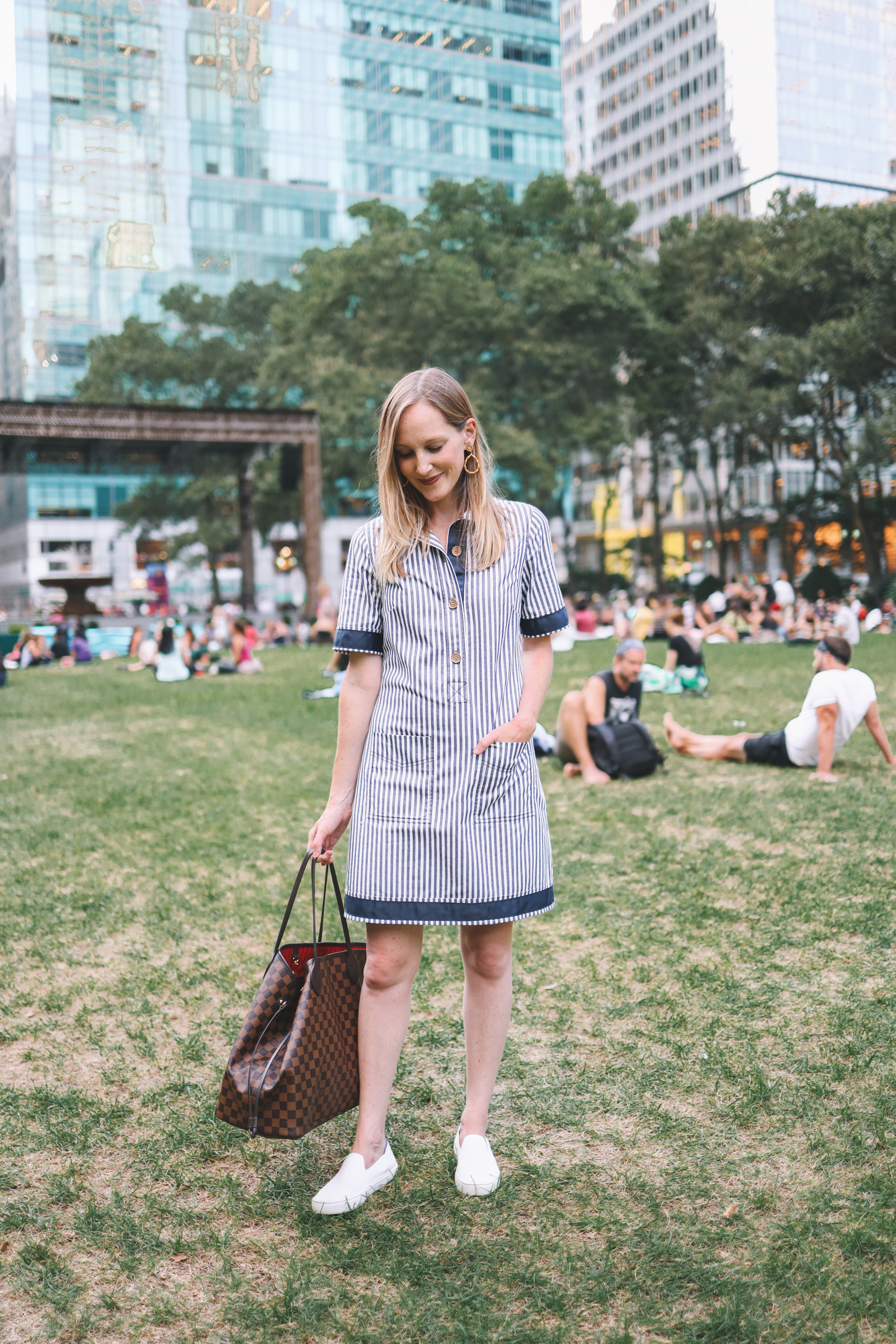 Kelly wearing a pin-stripped easy shirtdress in the city